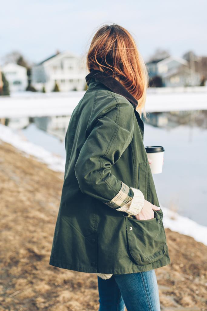 Jess Ann Kirby wearing a Barbour Jacket in Newport, RI