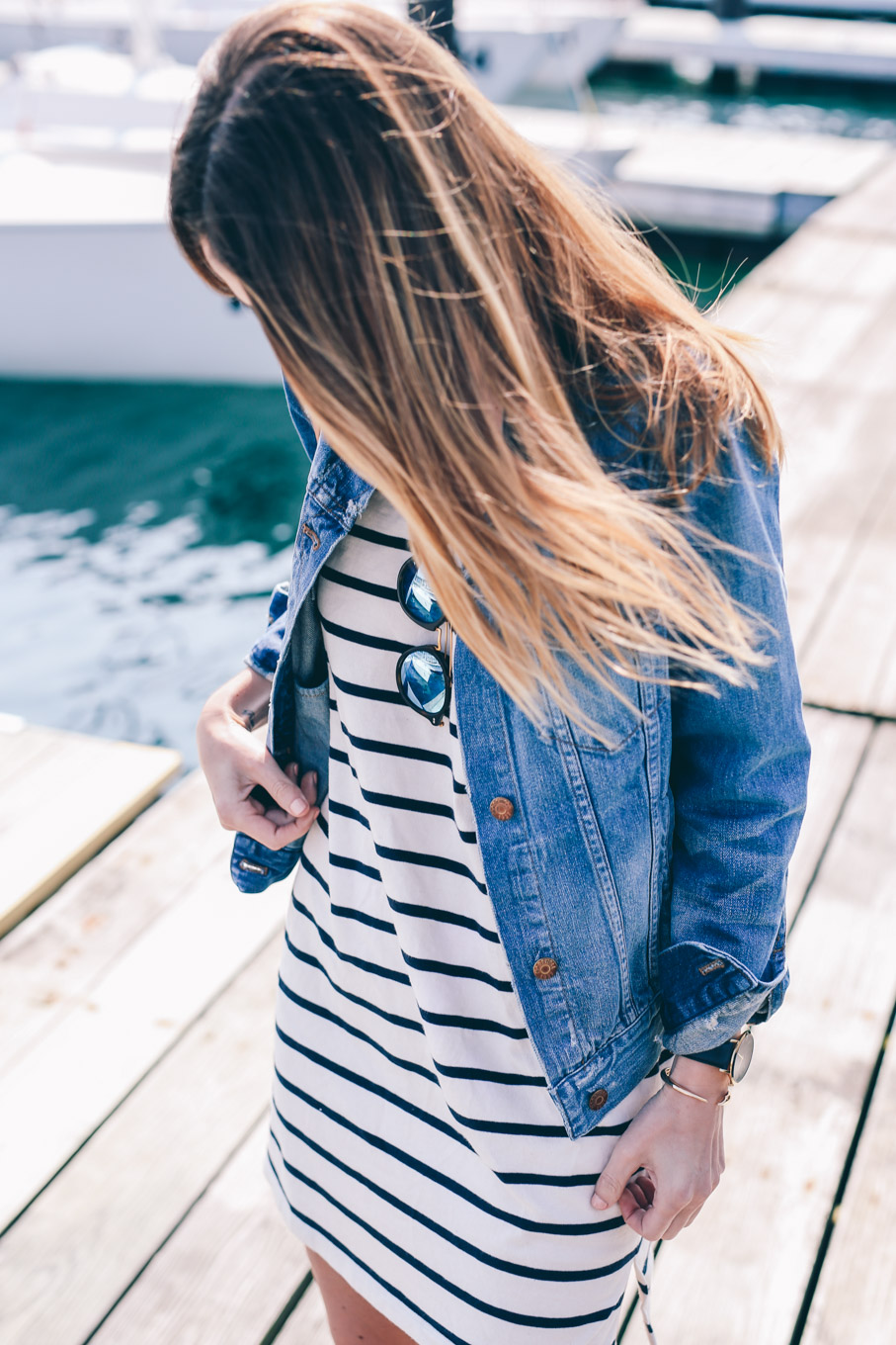 Jess Kirby wearing a striped cotton dress and Madewell jean jacket