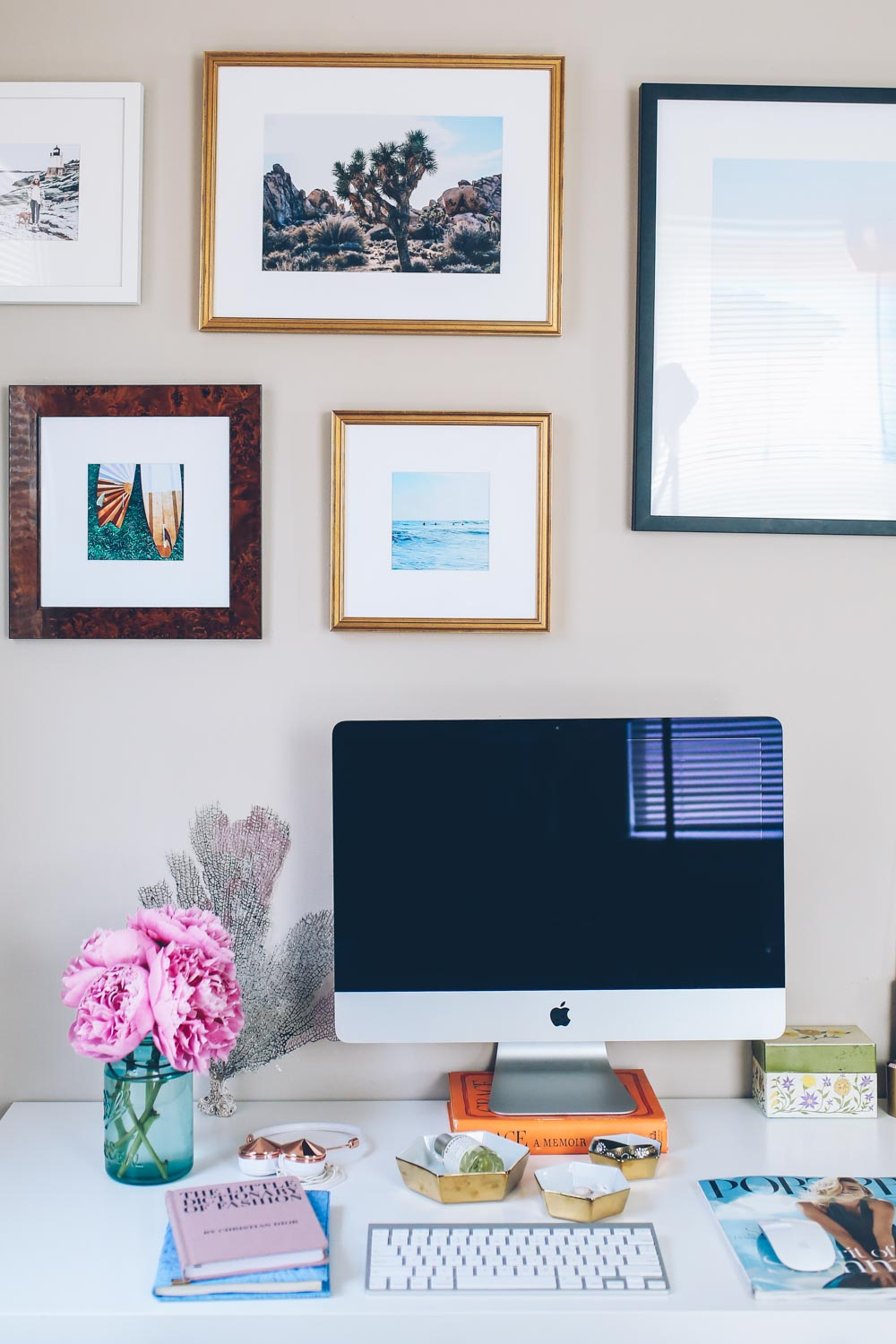 Jess Ann Kirby's home office setup with a gallery wall