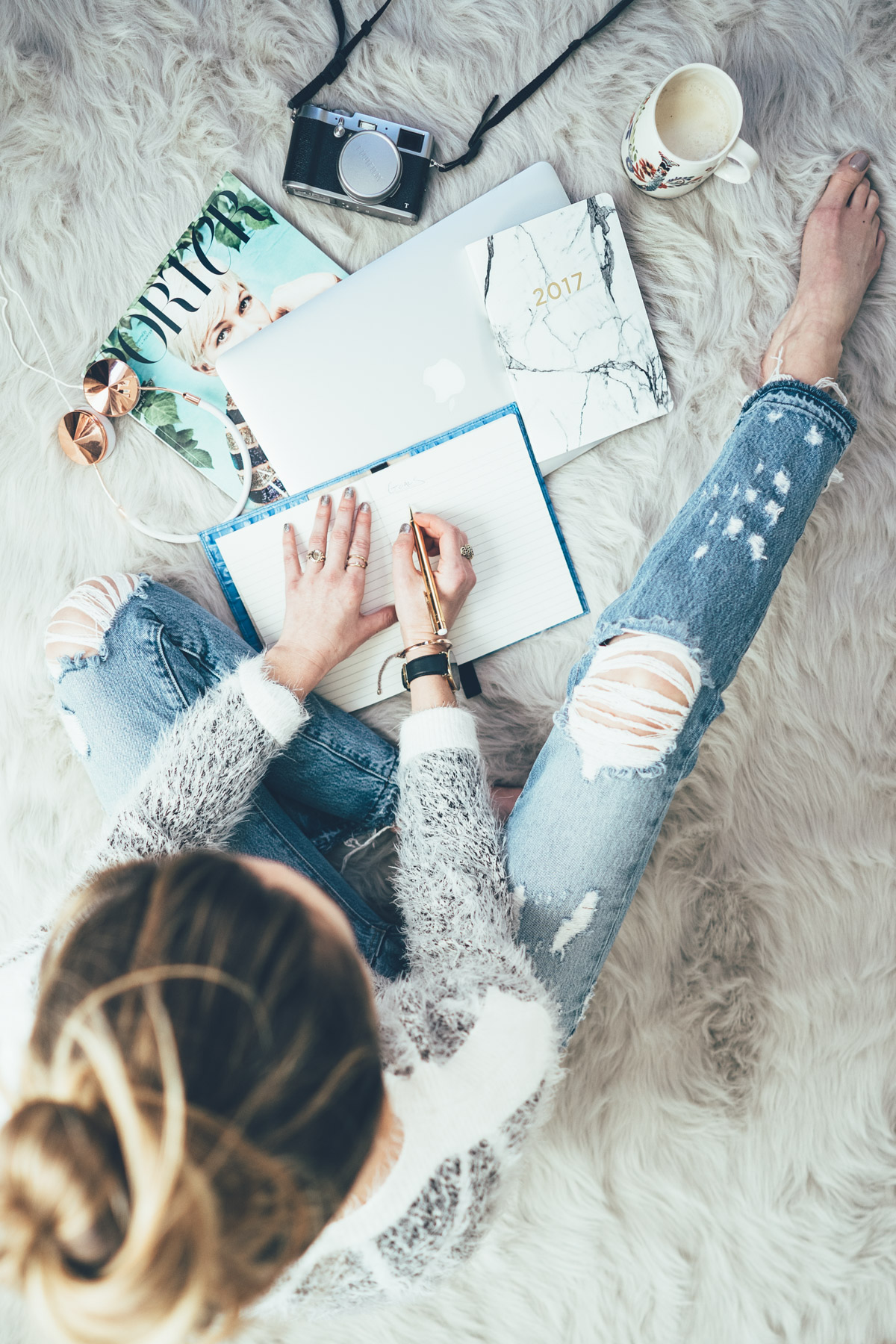 Jess Ann Kirby gets some work done in ripped jeans