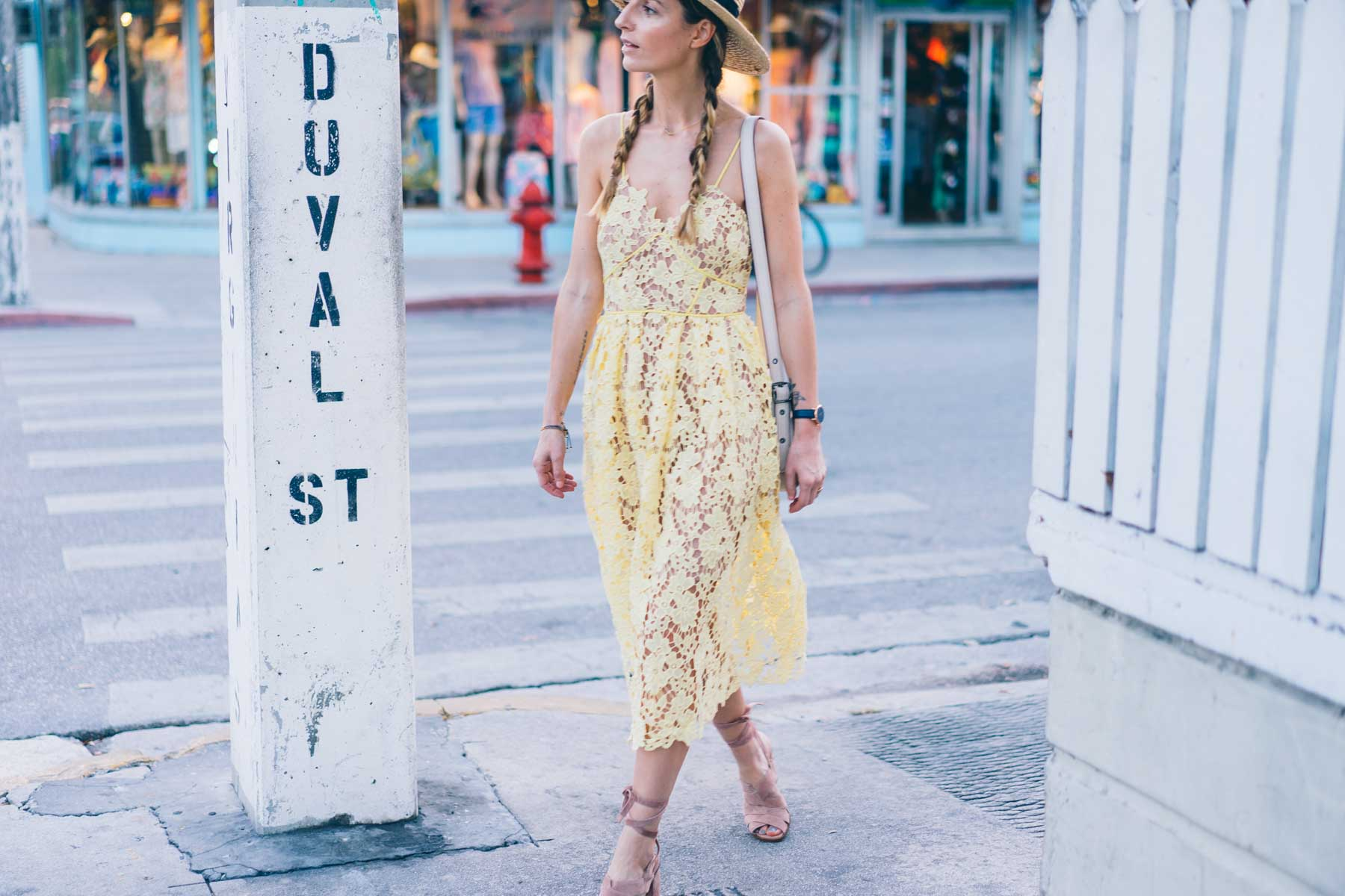 Jess Ann Kirby wears a yellow lace dress from Anthropologie in Key West