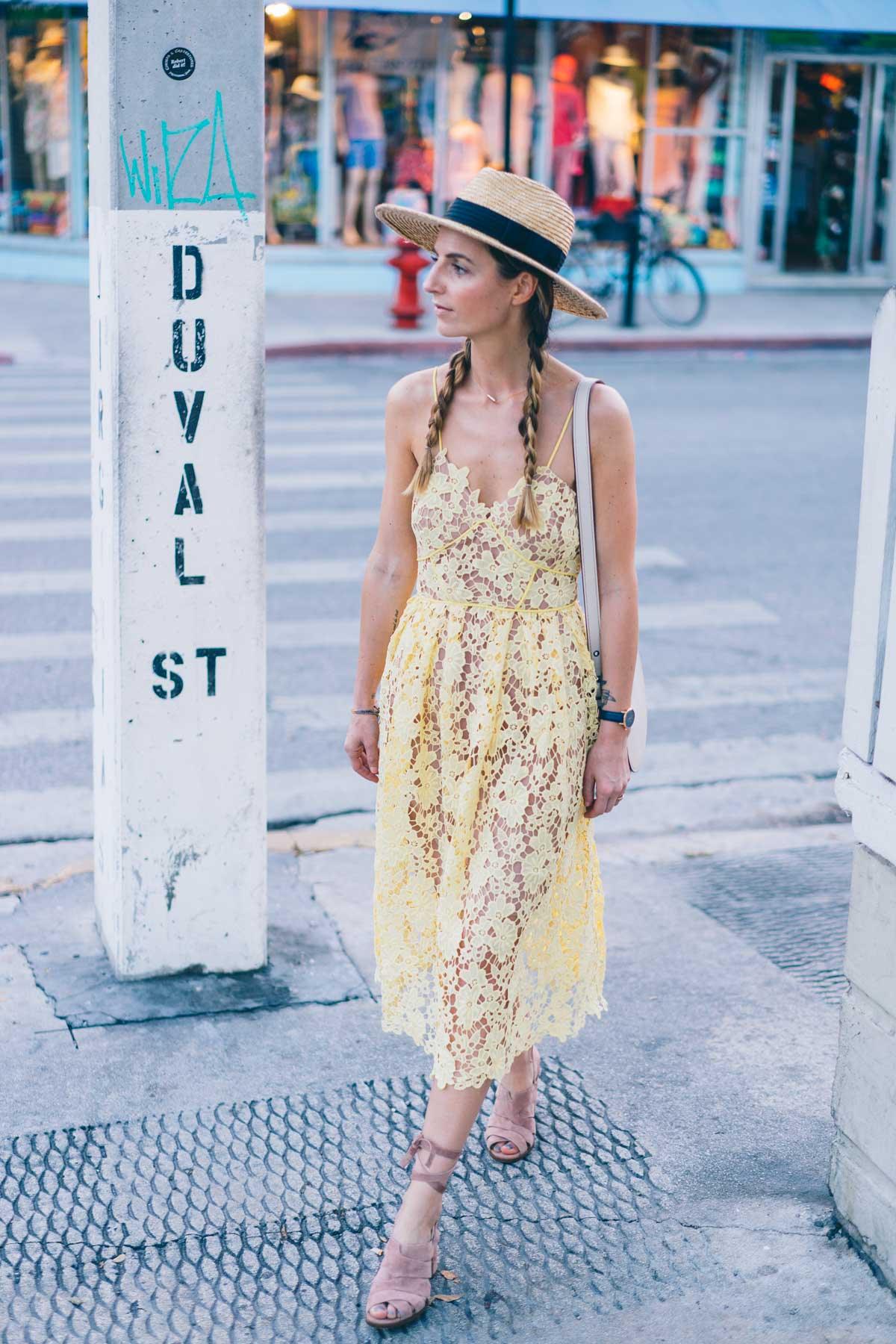 Jess Kirby wears two spring trends, a yellow lace dress and lace up heels