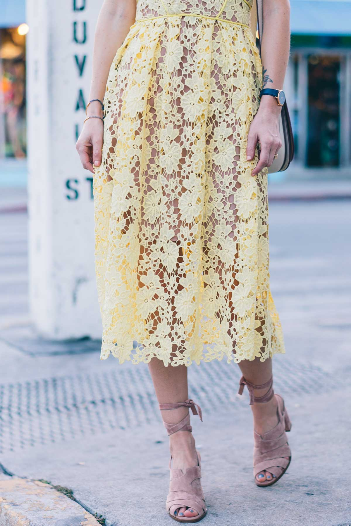 Spring trends to try, a yellow lace dress and lace up sandals on Jess Kirby