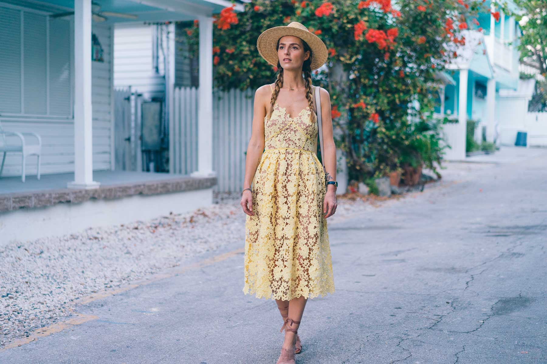 Jess Ann Kirby wearing a yellow lace midi dress in Key West