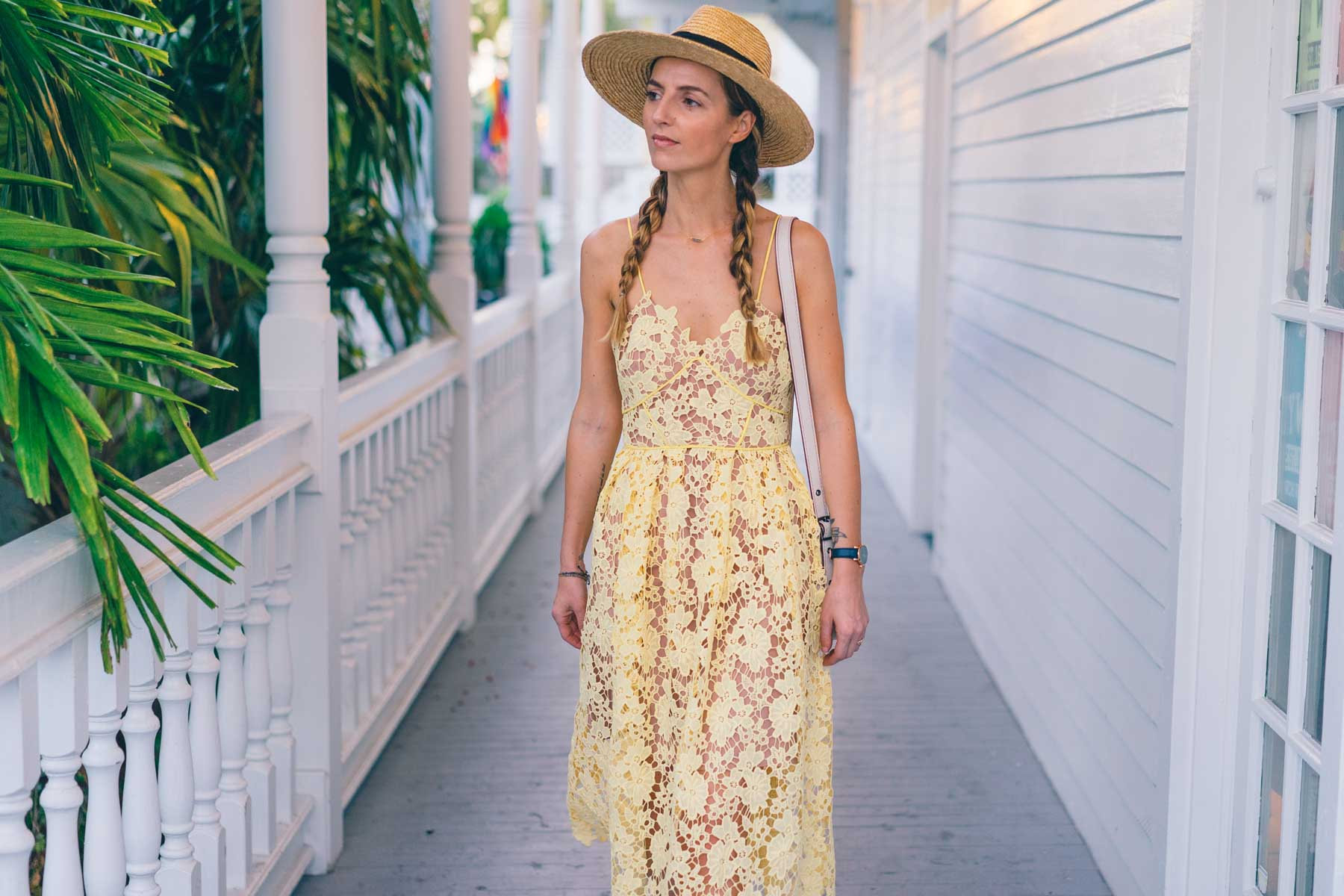Jess Kirby in Key west wearing a yellow lace midi dress