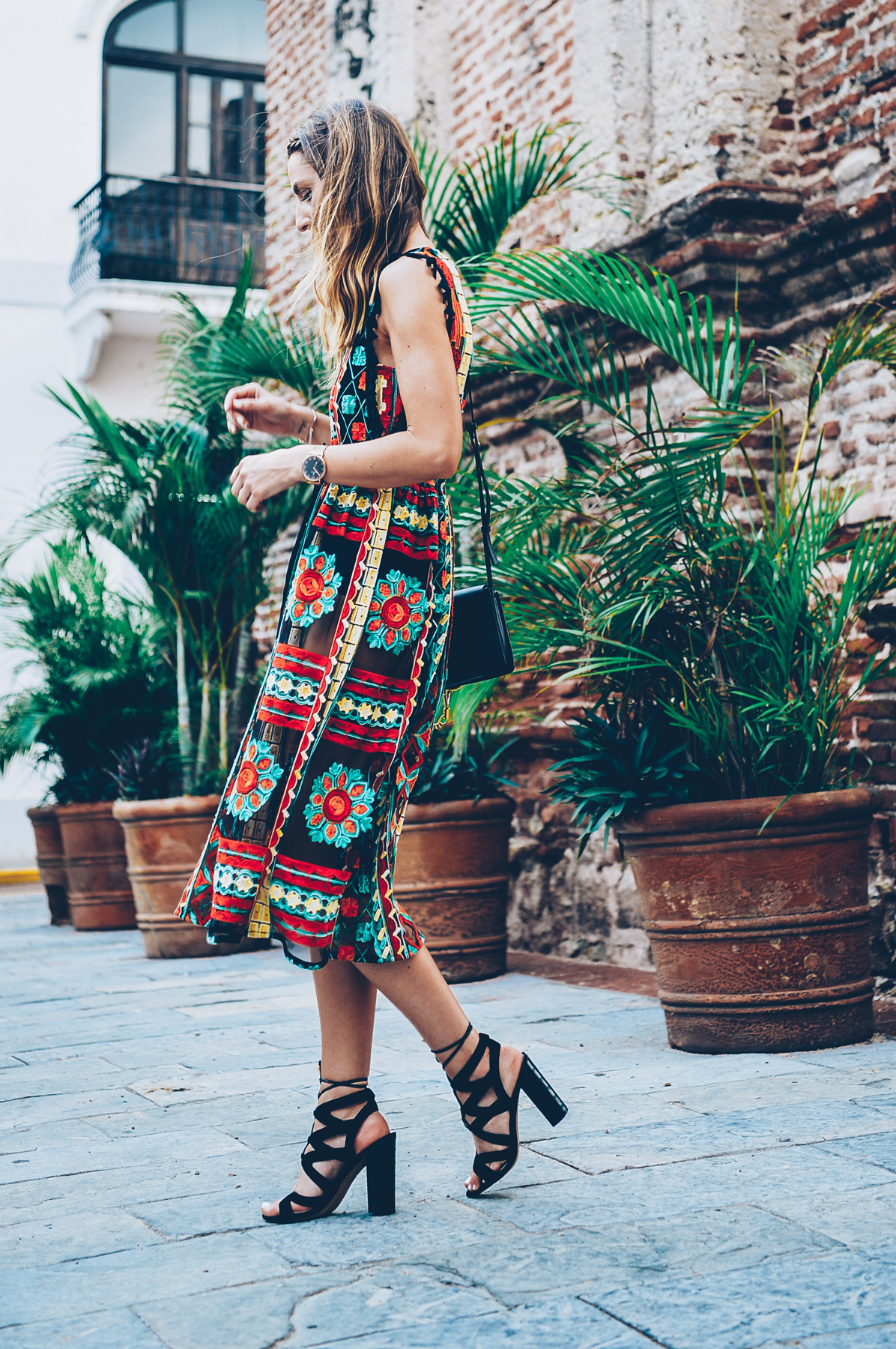 Jess Kirby wearing the Eva Franco Saskia Embroidered Dress from Anthropologie with Lace up heels in Panama City