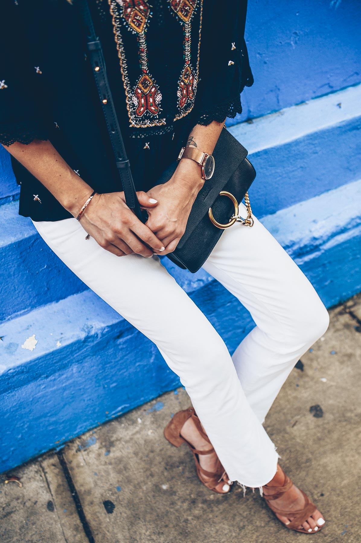 Jess Ann Kirby wearing Sam Edelman Sheri Lace Up Sandals and Paige Denim Colette White Cropped Jeans with a Raw Hem