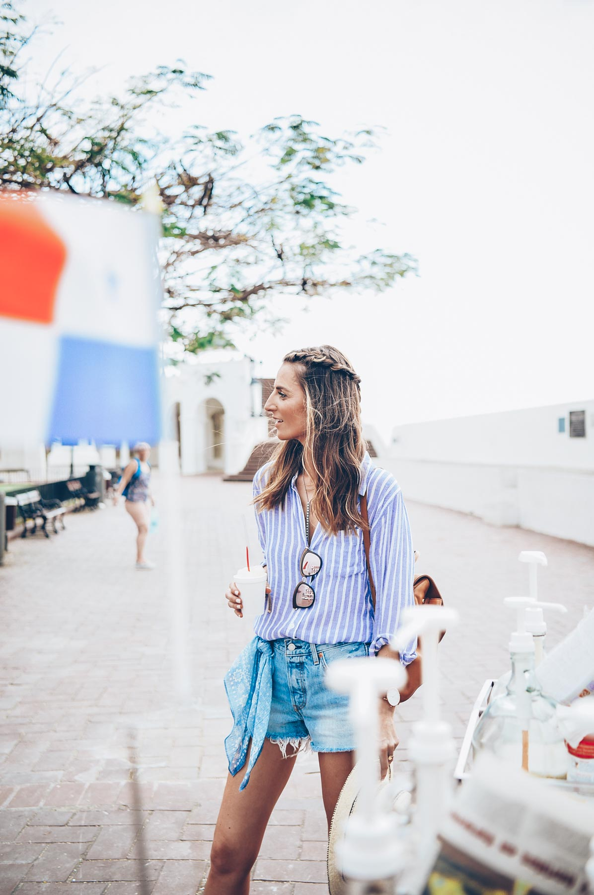 Jess Kirby exploring Casco Viejo in levis cutoff shorts and a stripe shirt
