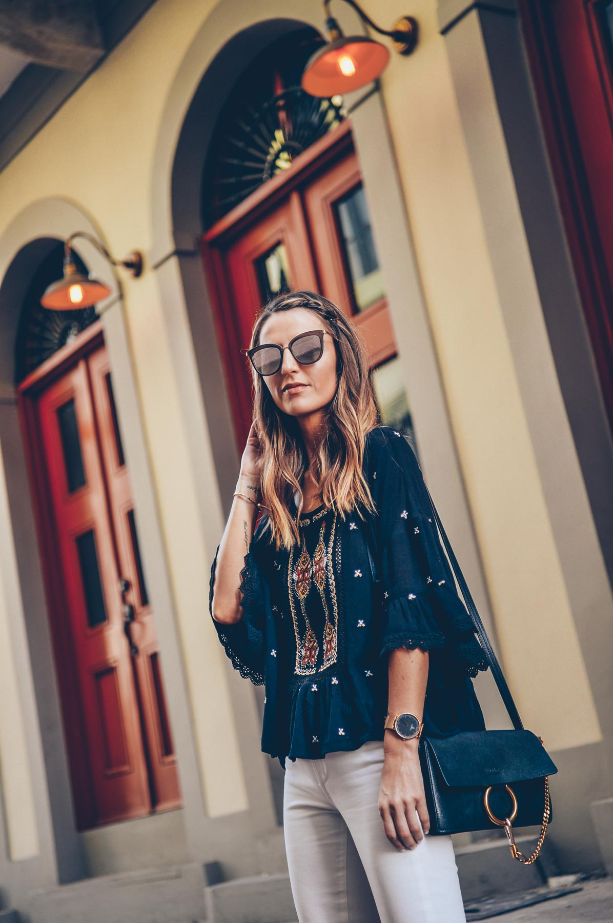 Jess Kirby wearing a boho blouse and Chloe Small Faye Crossbody in Panama City