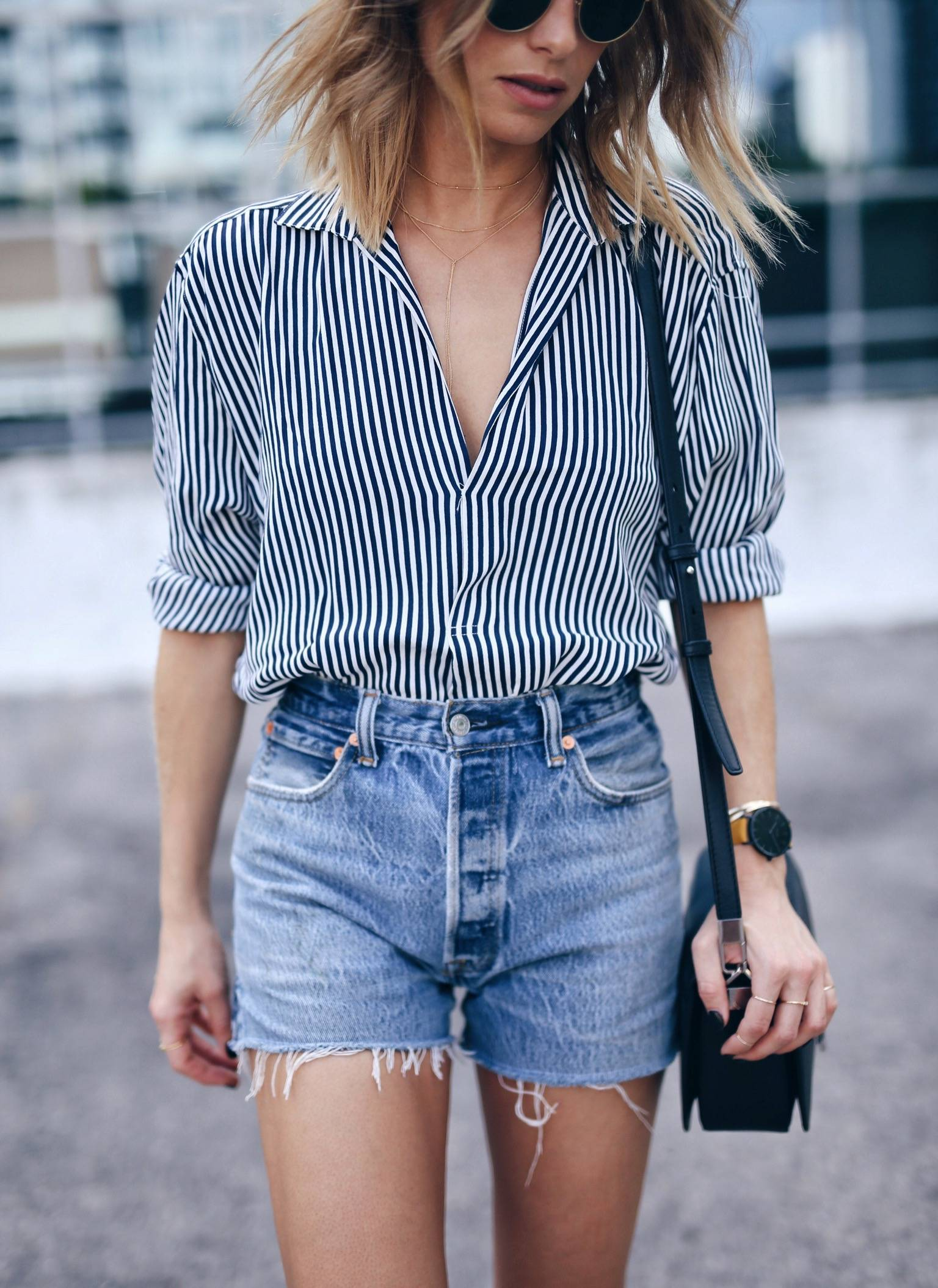 Jill Lansky of the August Diaries wearing denim cut-off shorts and striped blouse