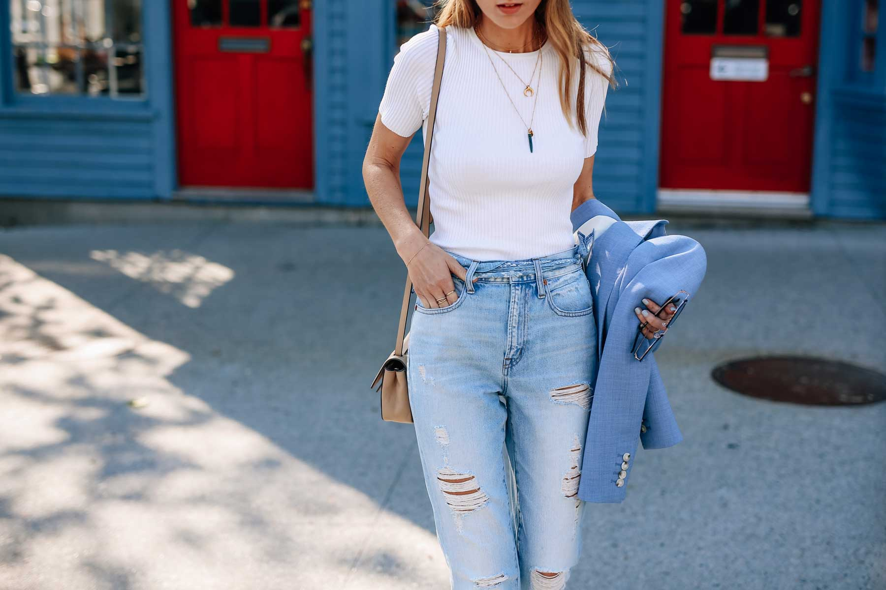 Jess Kirby styling boyfriend jeans with Missoma Malachite Tusk Pendant and Horn Necklace