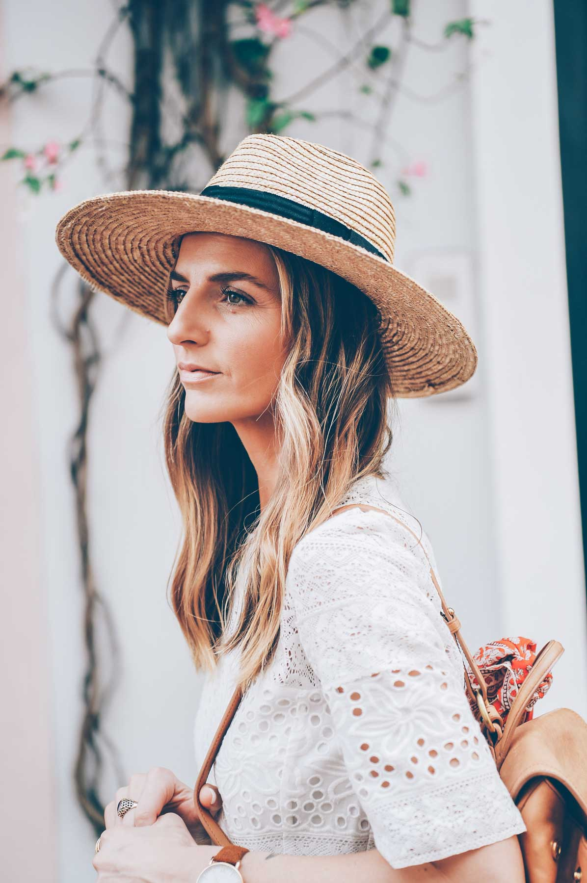 Jess Kirby wearing a Panama Hat and Balayage Wavy BLonde Hair
