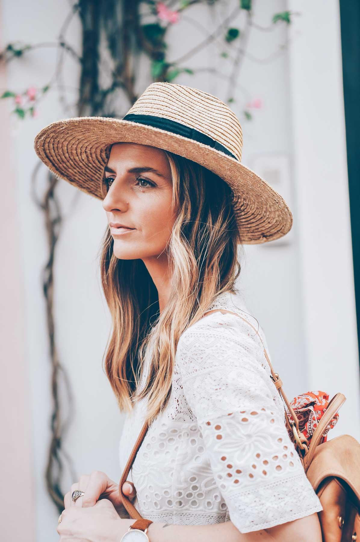 Jess Kirby wearing a Panama Hat and Balayage Wavy BLonde Hair