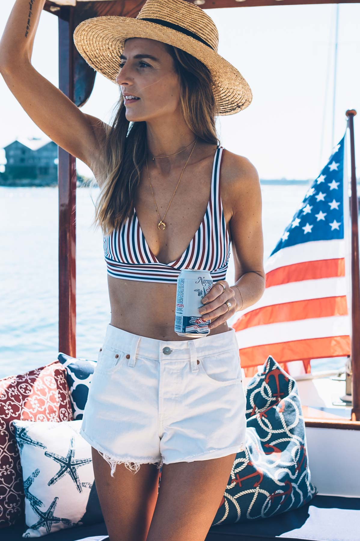 Jess Kirby wearing a Boys + Arrows striped bikini with Levi's wedgie high rise shorts for July 4th