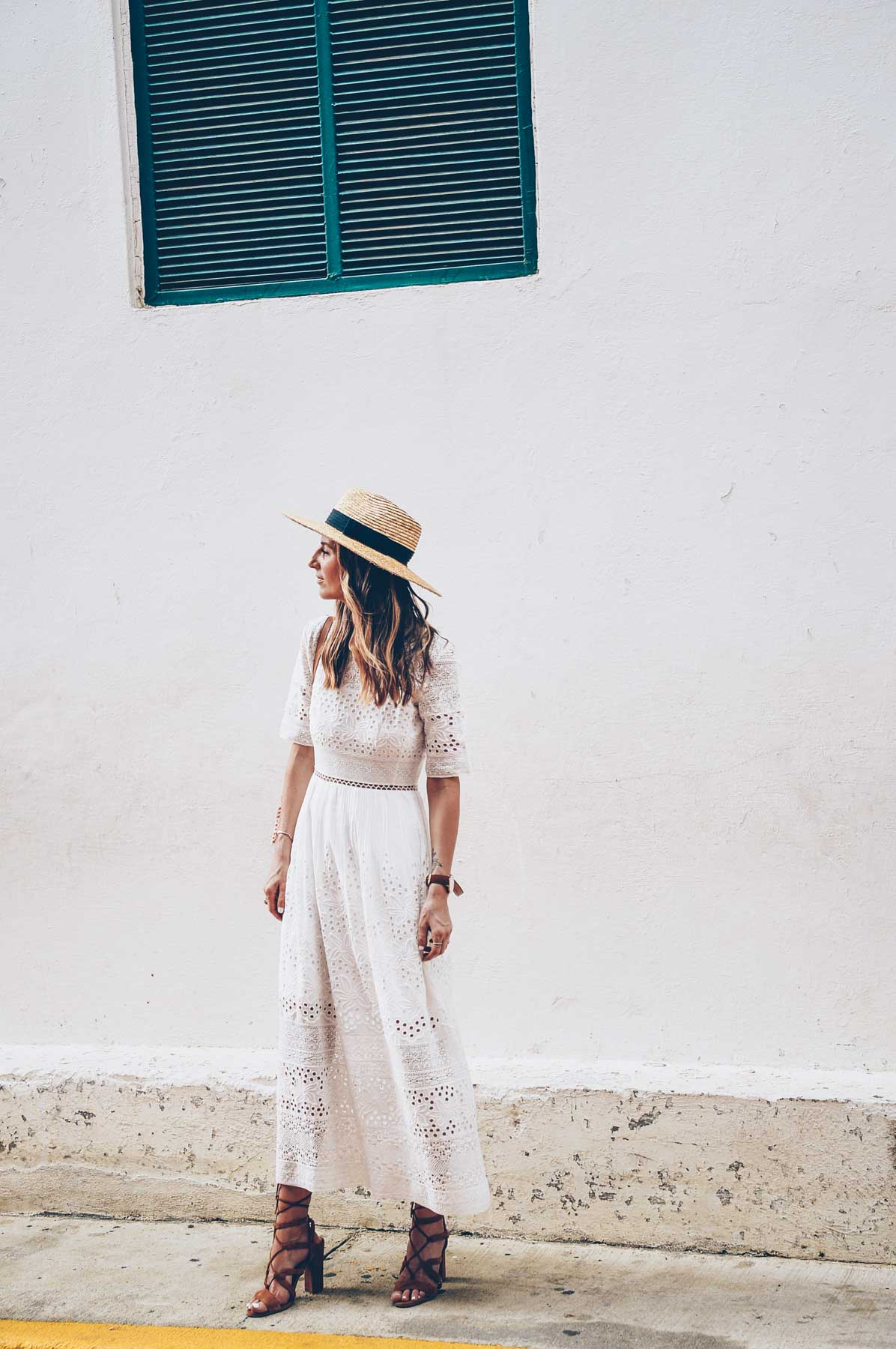 Jess Kirby wearing a white eyelet maxi dress from French Connection in Panama City
