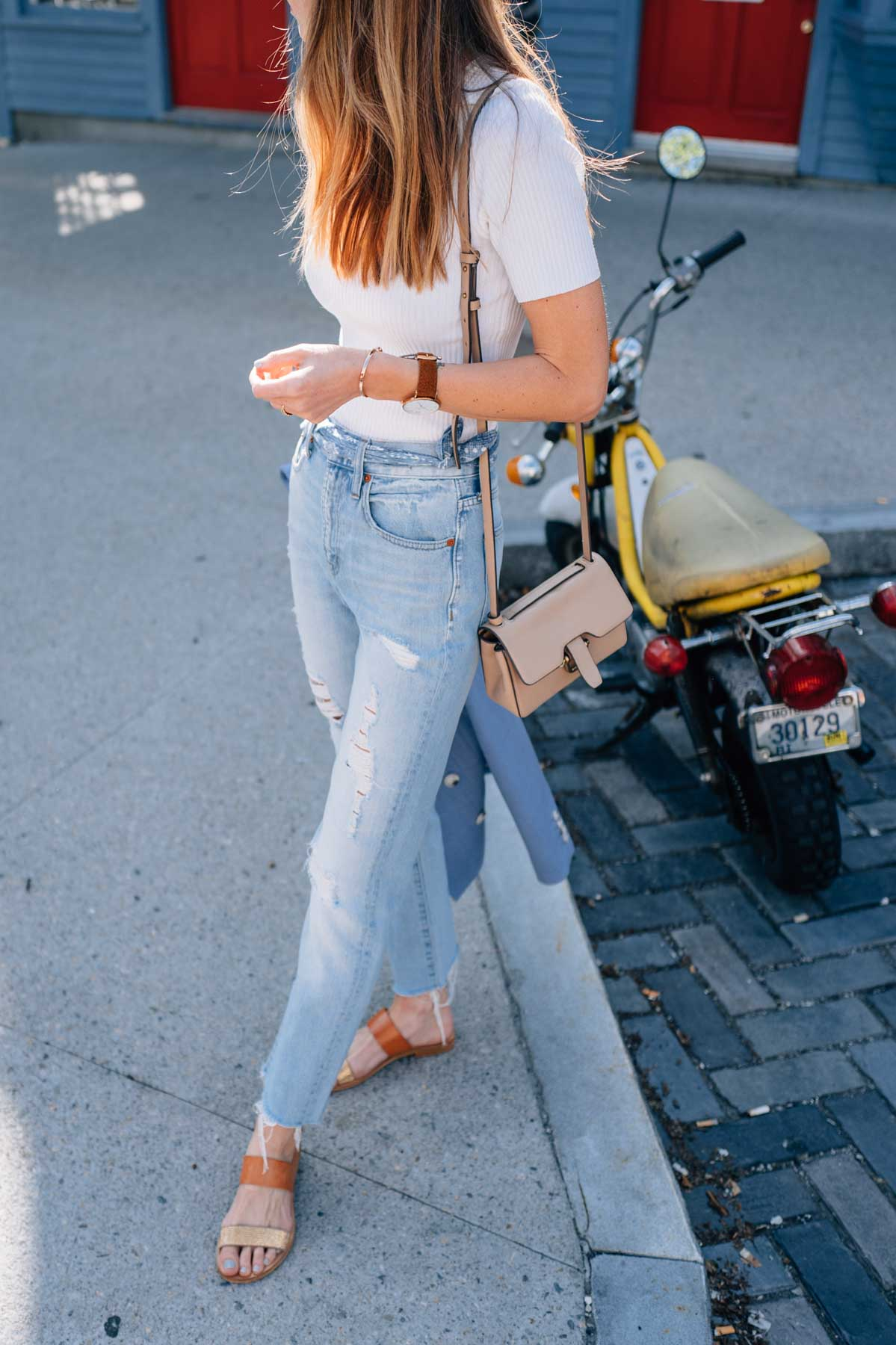 Jess Kirby wearing the Madewell Perfect Summer Jean with Cocobelle Leather Sandals and the J.Crew Edit Bag in Newport, rI