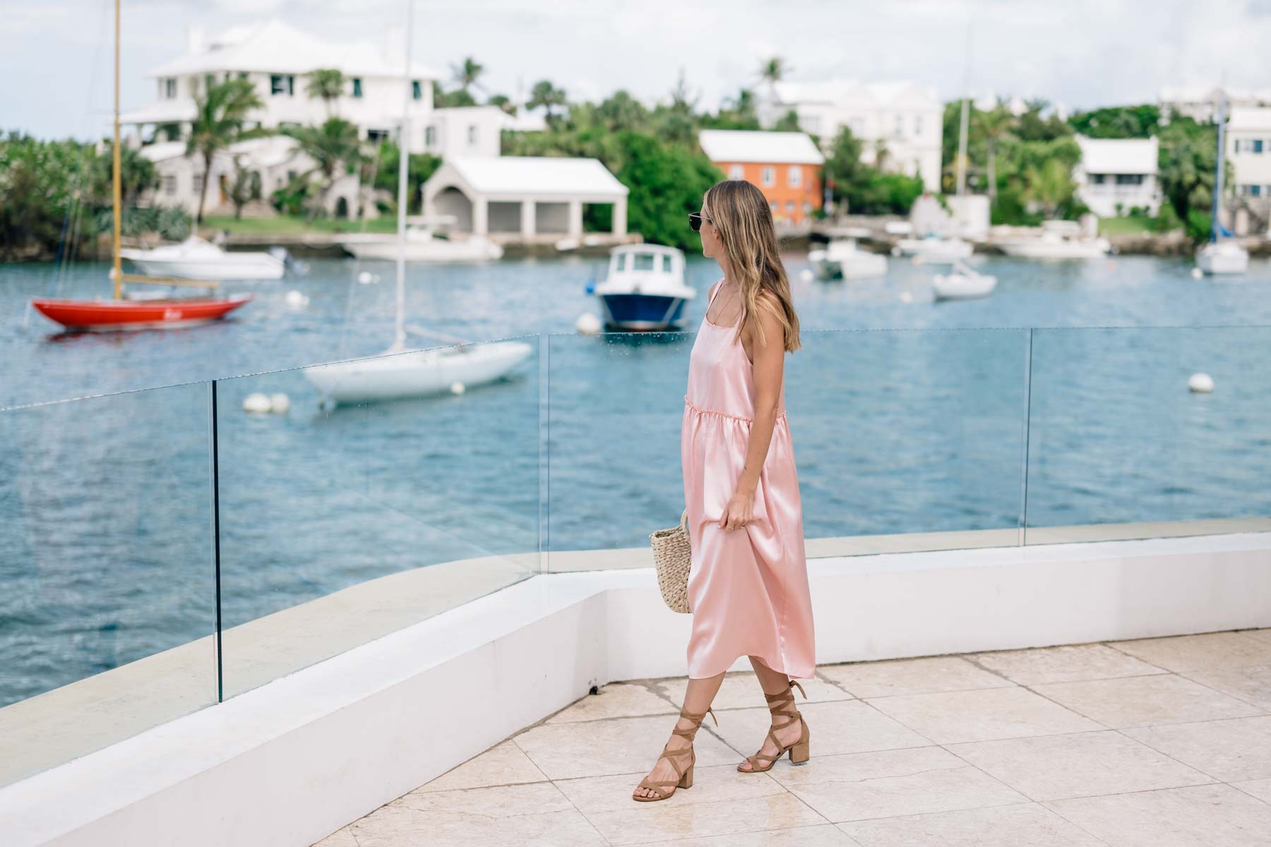 Jess Ann Kirby in Bermuda wearing a Blush Midi Dress by Steele from Anthropologie