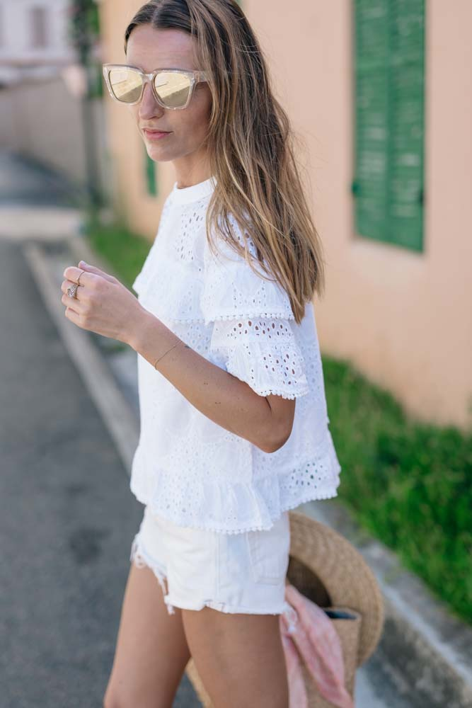 Jess Kirby wearing a lace top and white cutoffs in Bermuda
