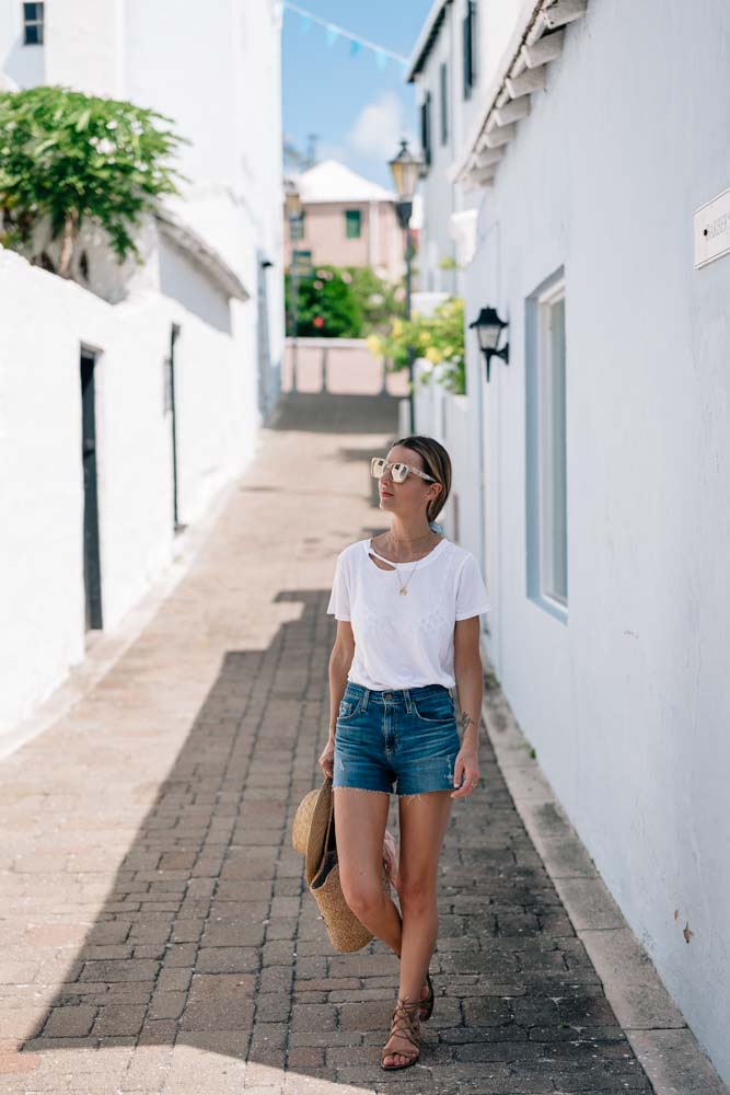 Jess Kirby wears AG Jean Shorts and a White Tee in Saint George Bermuda