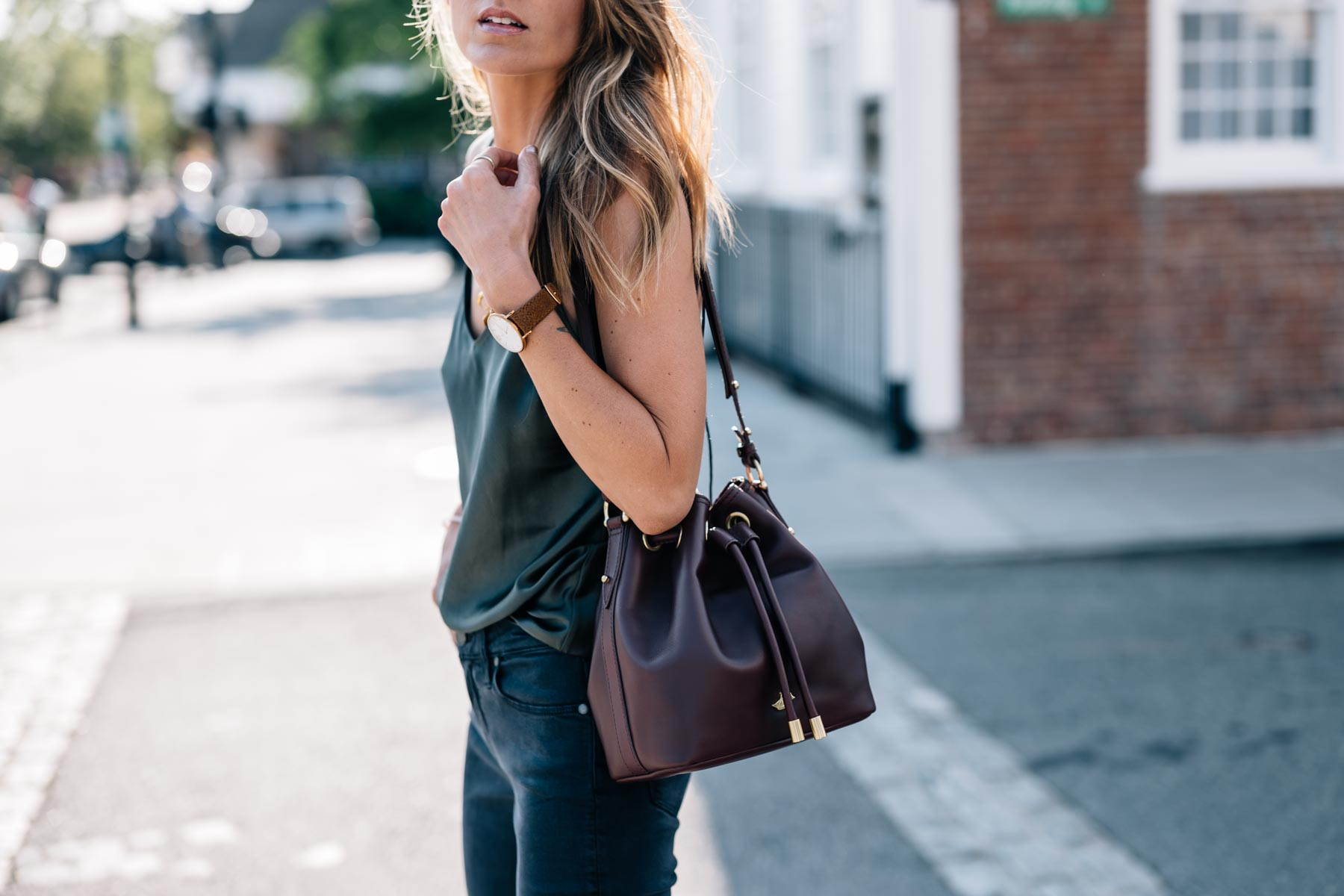 Jess Ann Kirby styles the Brahmin Isabelle Charleston Bag with a silk tank