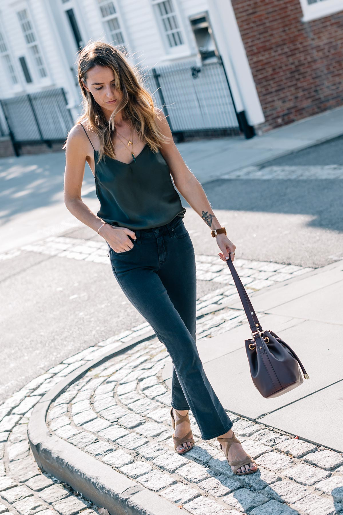 Transitional style for summer to fall on Jess Ann Kirby wearing the Paige Cecily Silk Camisole and Jocelyn Crop Flare