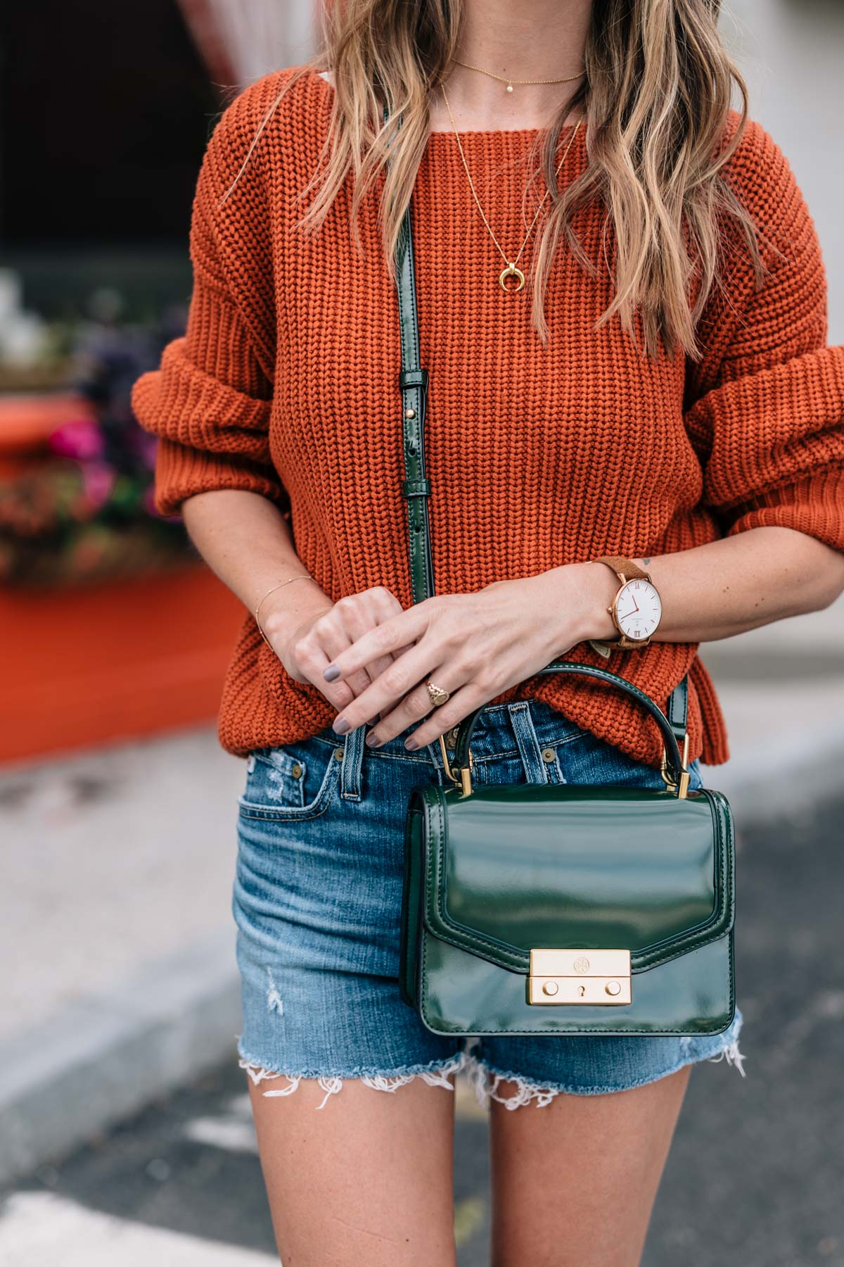 Jess Ann Kirby styles the fall color trend autumn maple in a chunky knit sweater with the tory burch juliette mini satchel