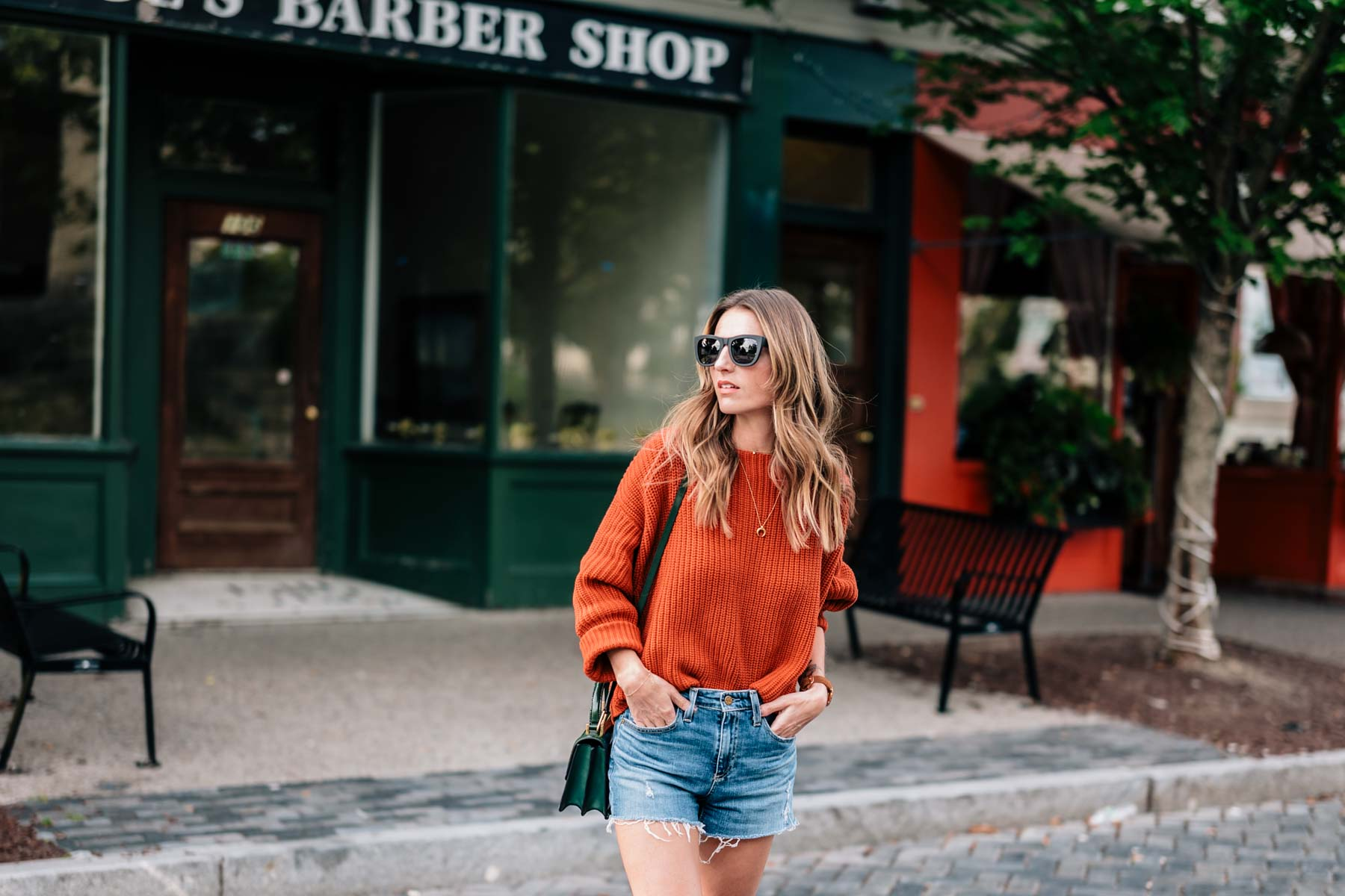Fall style inspiration from Jess Kirby in a chunky knit sweater and jean shorts