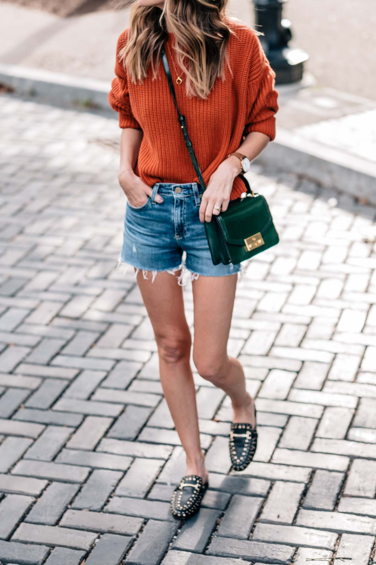 Fall style on Jess Kirby wearing a chunky knit sweater, jean shorts and sam edelman marilyn studded slides