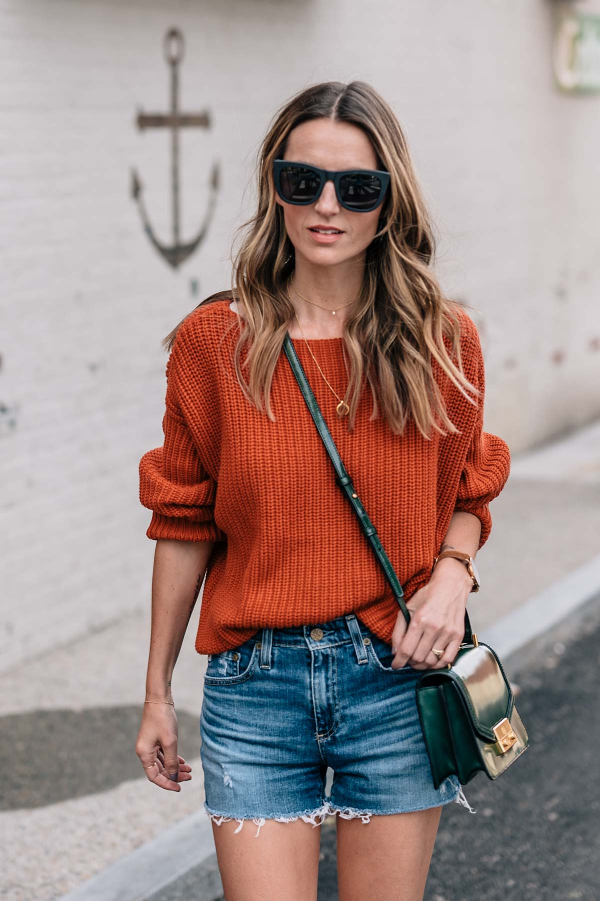 Jess Ann Kirby styles pantone autumn maple in the French Connection Millie mozart sweater and AG jean shorts