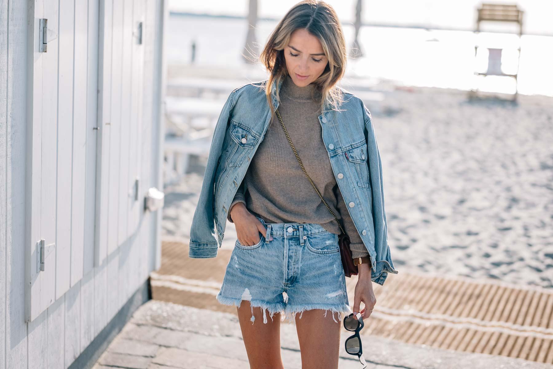 Jess Kirby wears the levis ex boyfriend trucker denim jacket, cashmere sweater and denim shorts