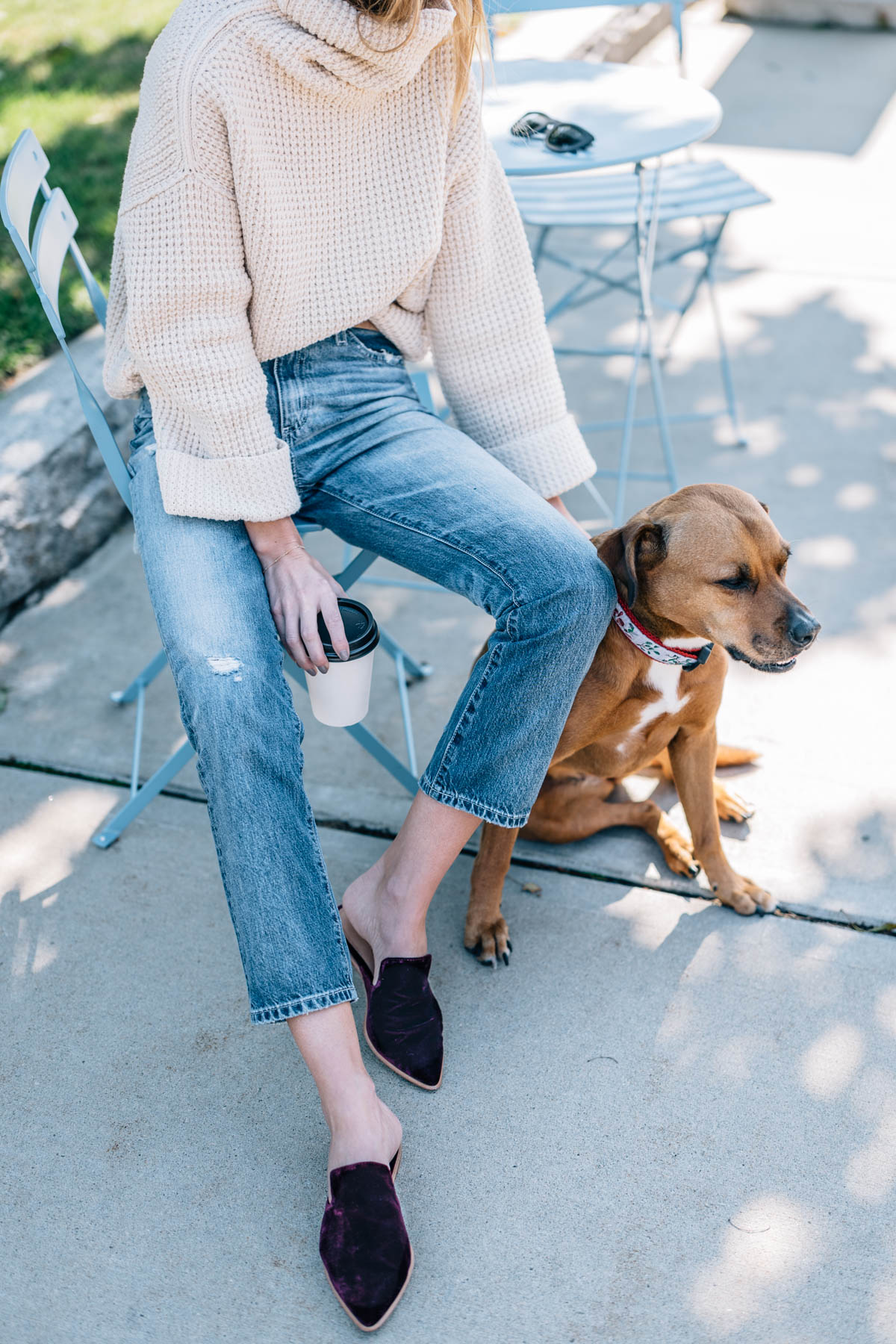 Jess Ann Kirby wearing a Free People Sweater, ag isabelle jeans and madewell velvet mules
