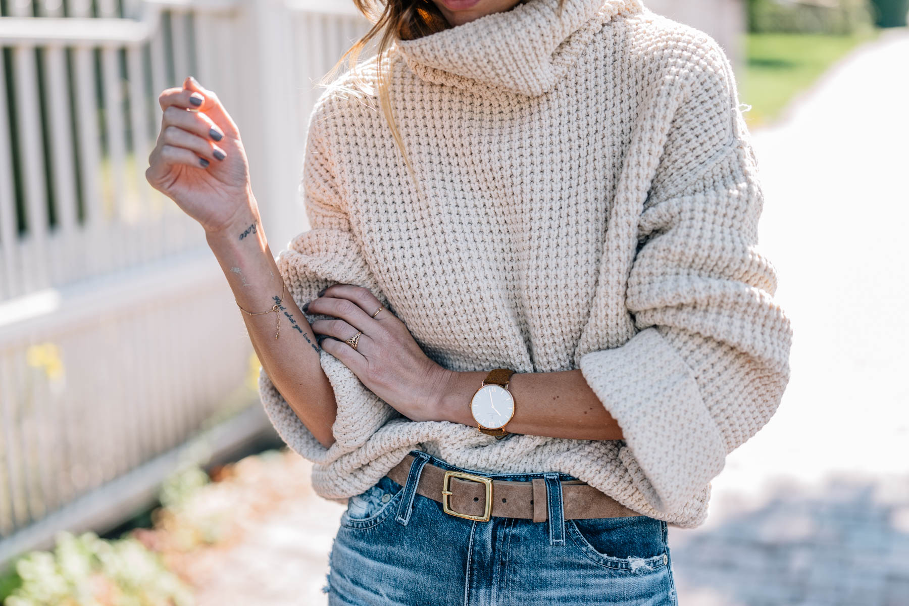 Jess Ann Kirby's fall style in a chunky knit turtleneck sweater with rag and bone leather belt