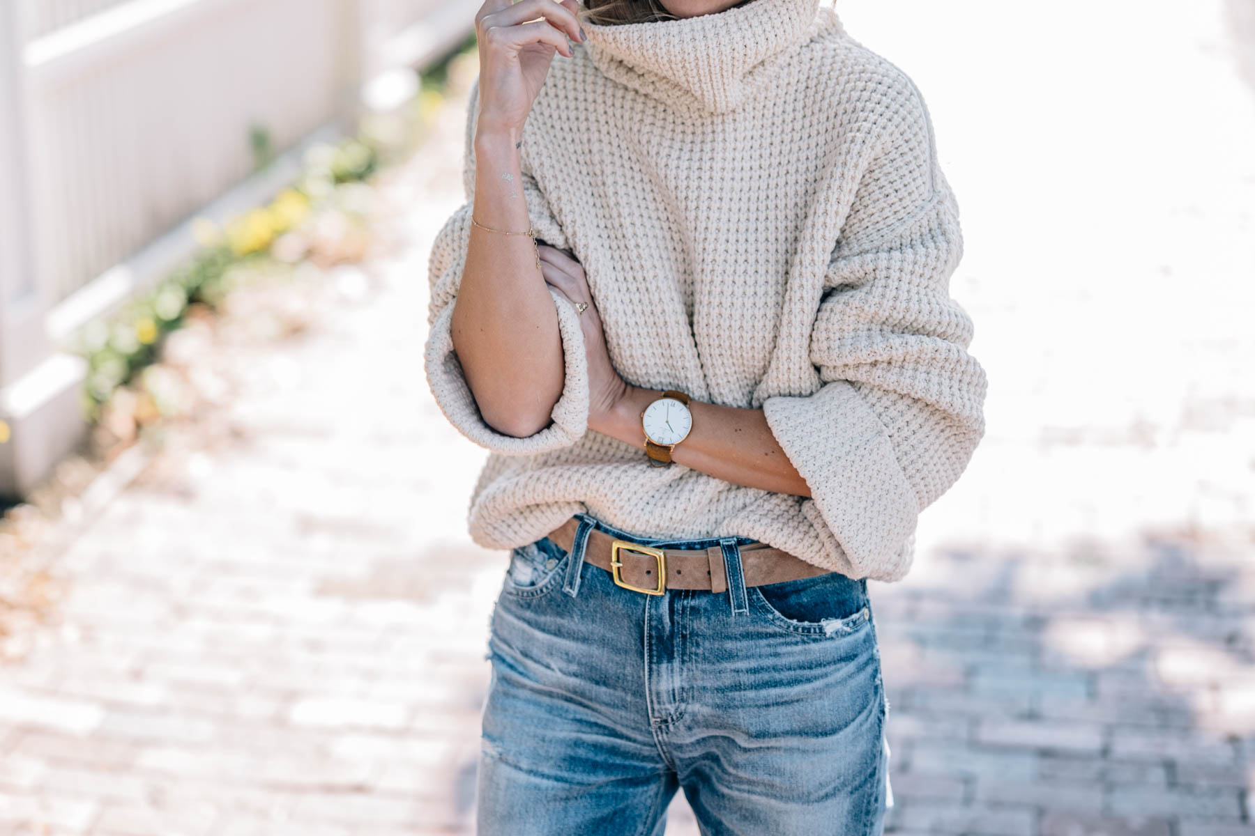 Jess Ann Kirby's fall style in a free people chunky knit turtleneck sweater and rag and bone leather belt