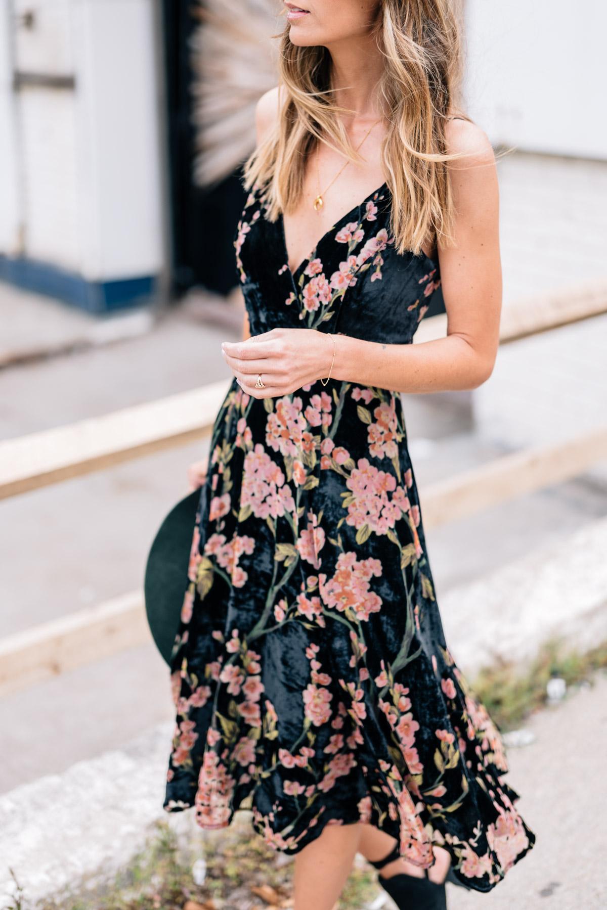 Jess Ann Kirby wears a floral velvet slip dress from Anthropologie for fall wedding style
