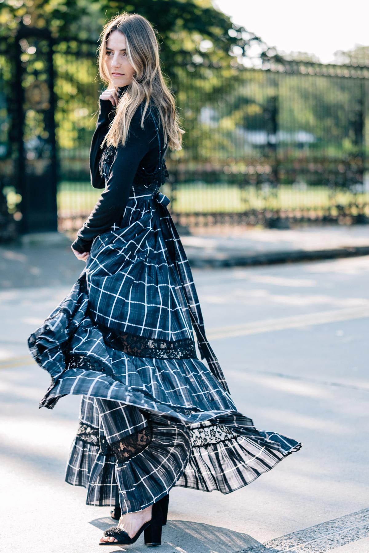 Jess Ann Kirby wears the Vetiver communication breakdown plaid maxi dress for a fall wedding