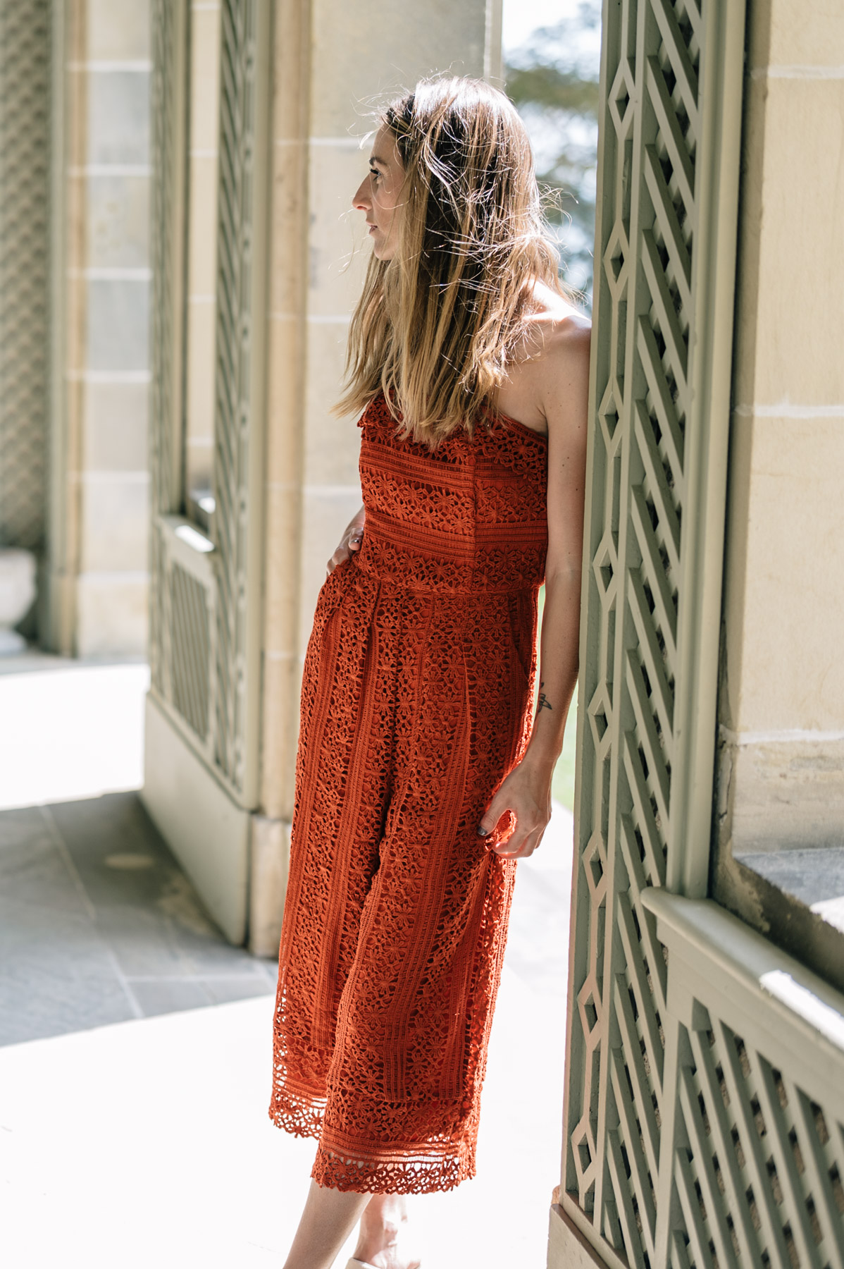 Jess Ann Kirby styles a strapless lace jumpsuit for fall wedding style