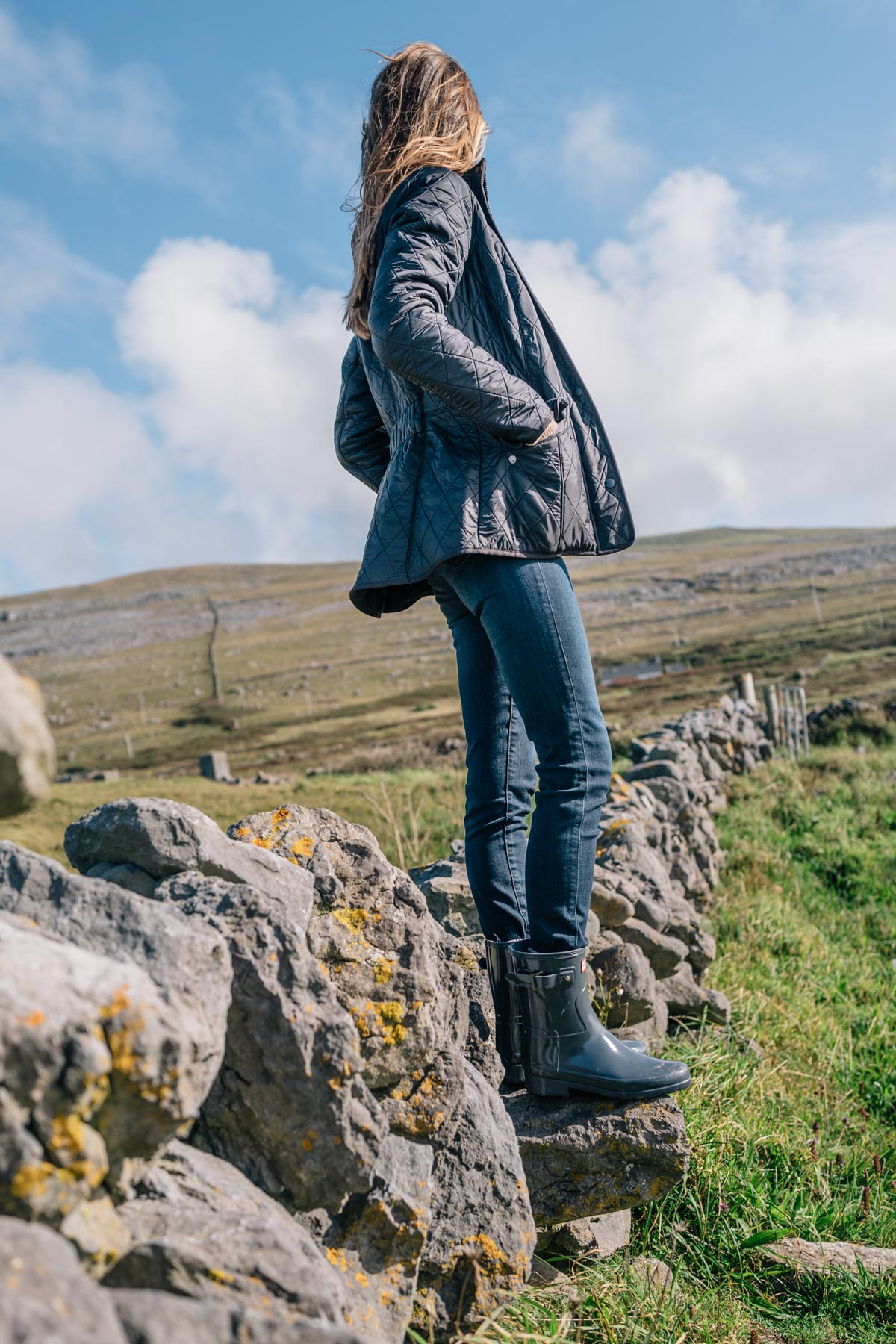 Jess Ann Kirby wearing a Barbour quilted jacket and Hunter boots in Ireland