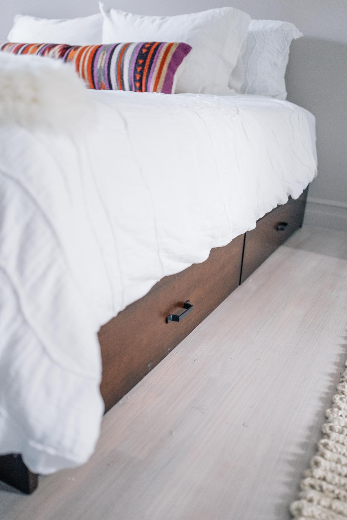 Jess Ann Kirby uses the Raymour & Flanigan under bed storage drawers for extra space in a bedroom