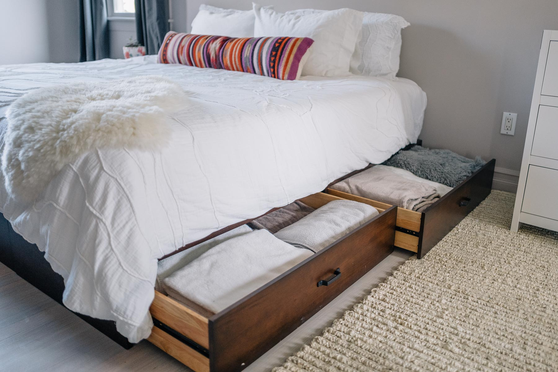 Jess Ann Kirby uses under bed storage for extra space in a bedroom