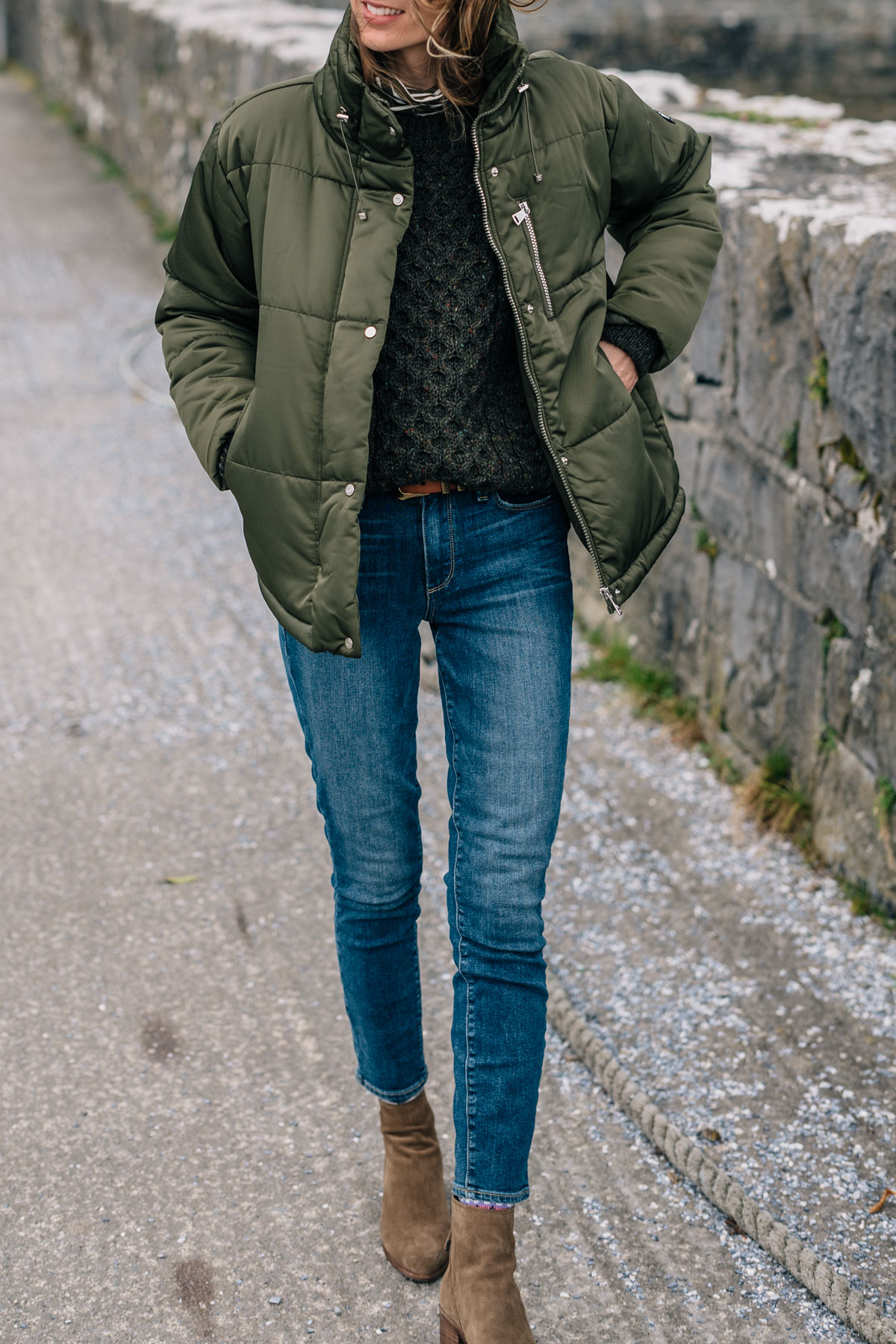Jess Ann Kirby fall outfit in an army green puffer coat and paige skinny jeans