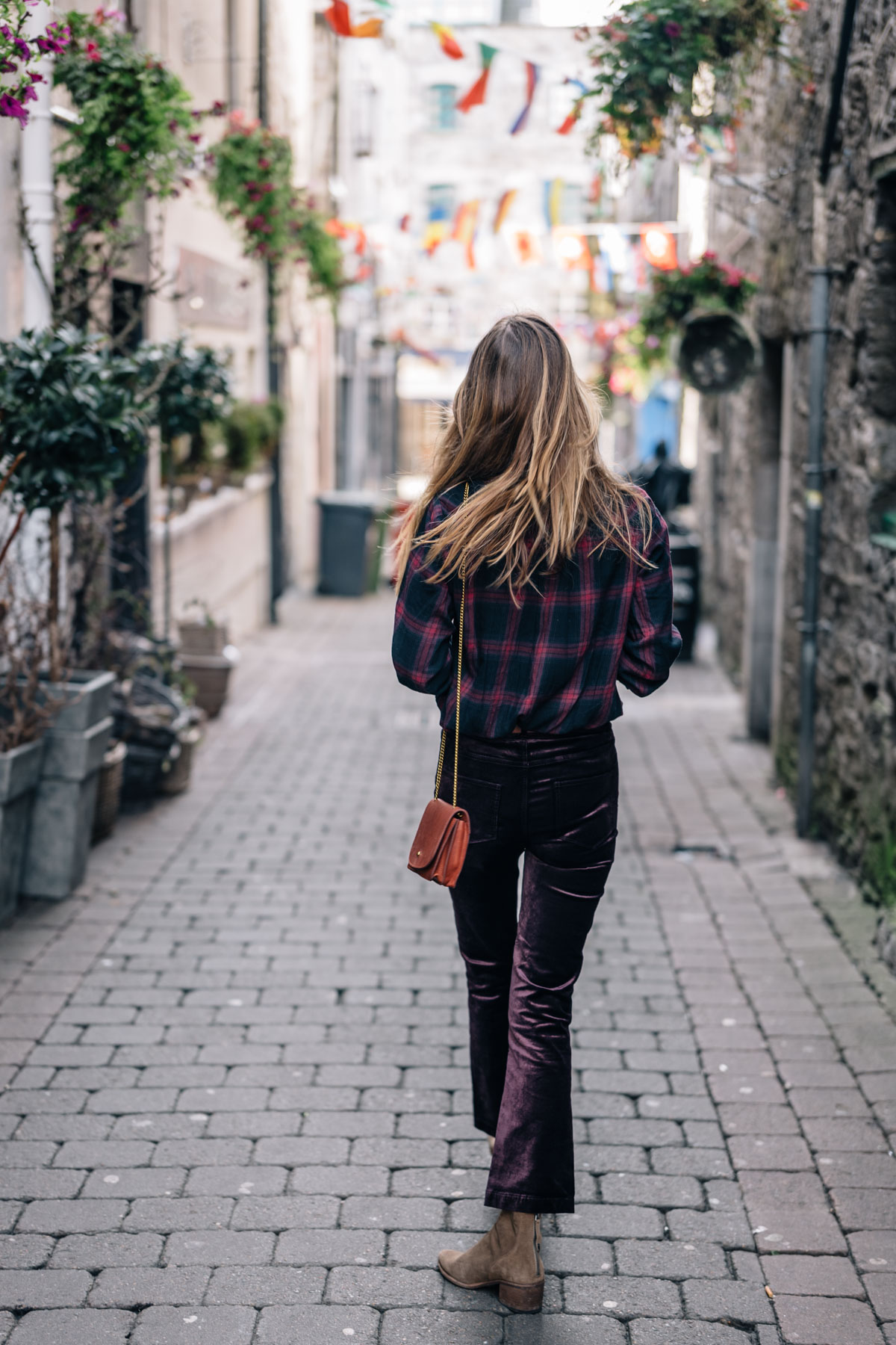 Jess Ann Kirby explores Galway, Ireland in Paige Denim Velvet Cropped Flare pants and Plaid Button Down