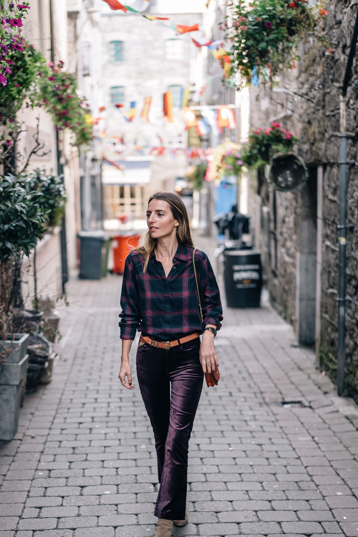 Jess Ann Kirby wears Paige Denim Velvet Cropped Flare pants and Plaid Button Down in Galway, Ireland