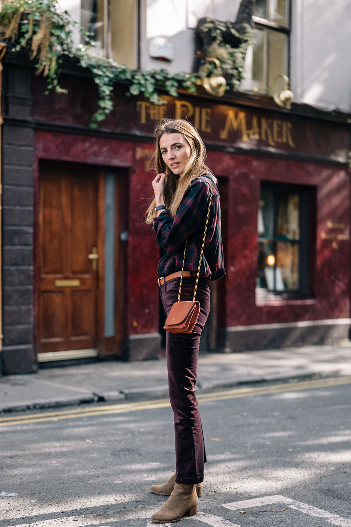 Jess Ann Kirby styles Paige Denim Velvet Pants with Ankle Booties and a Plaid Shirt