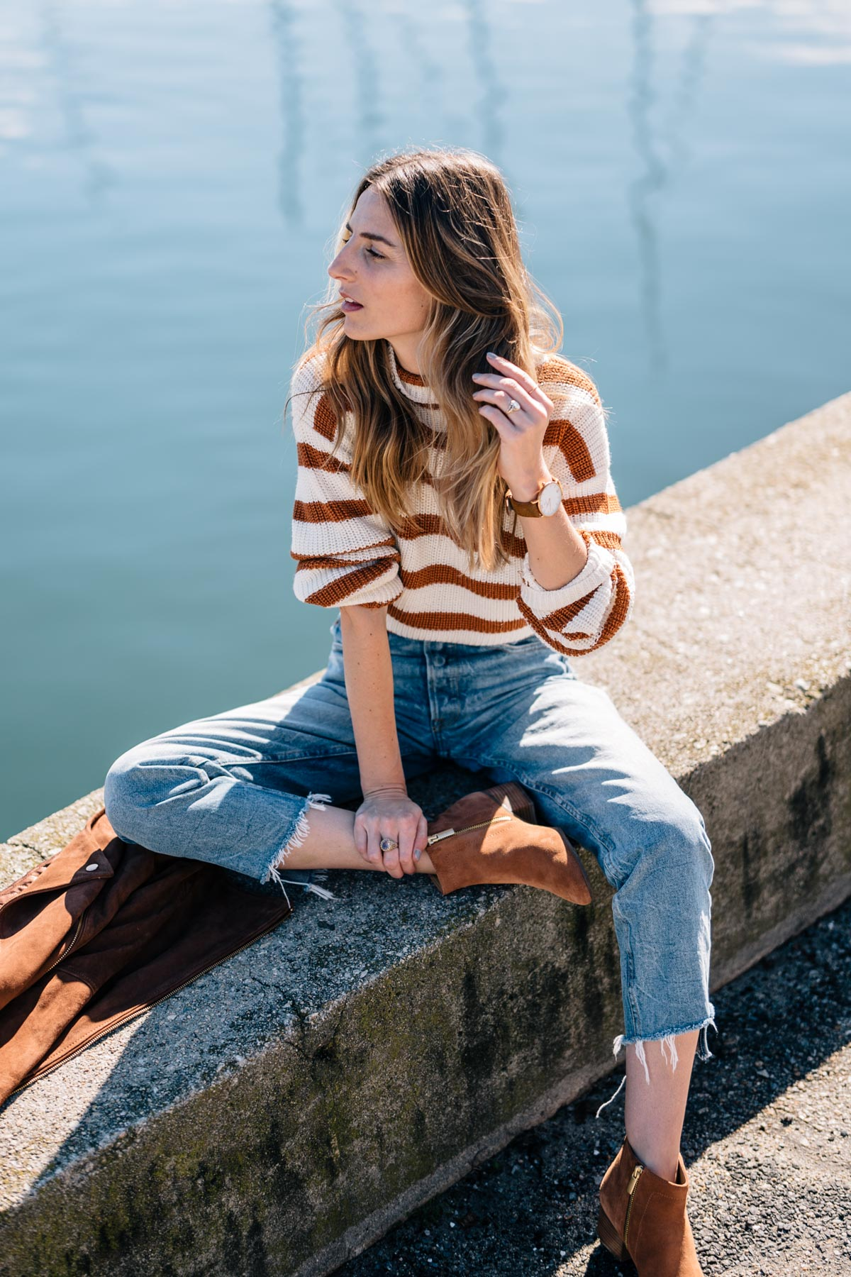 Jess Ann Kirby wears the Paper Crown Vancouver Sweater and GRLFRND Denim for the perfect fall outfit