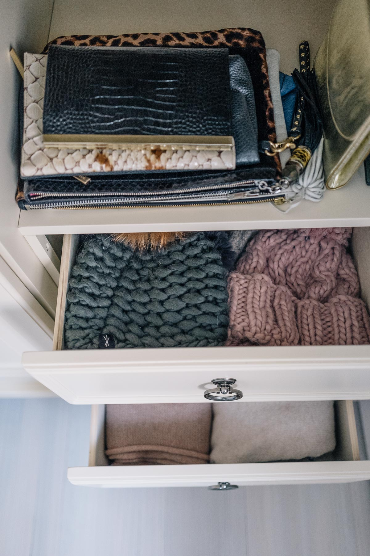 Jess Ann Kirby uses the Raymour & Flanigan wardrobe dresser to store winter hats and scarves