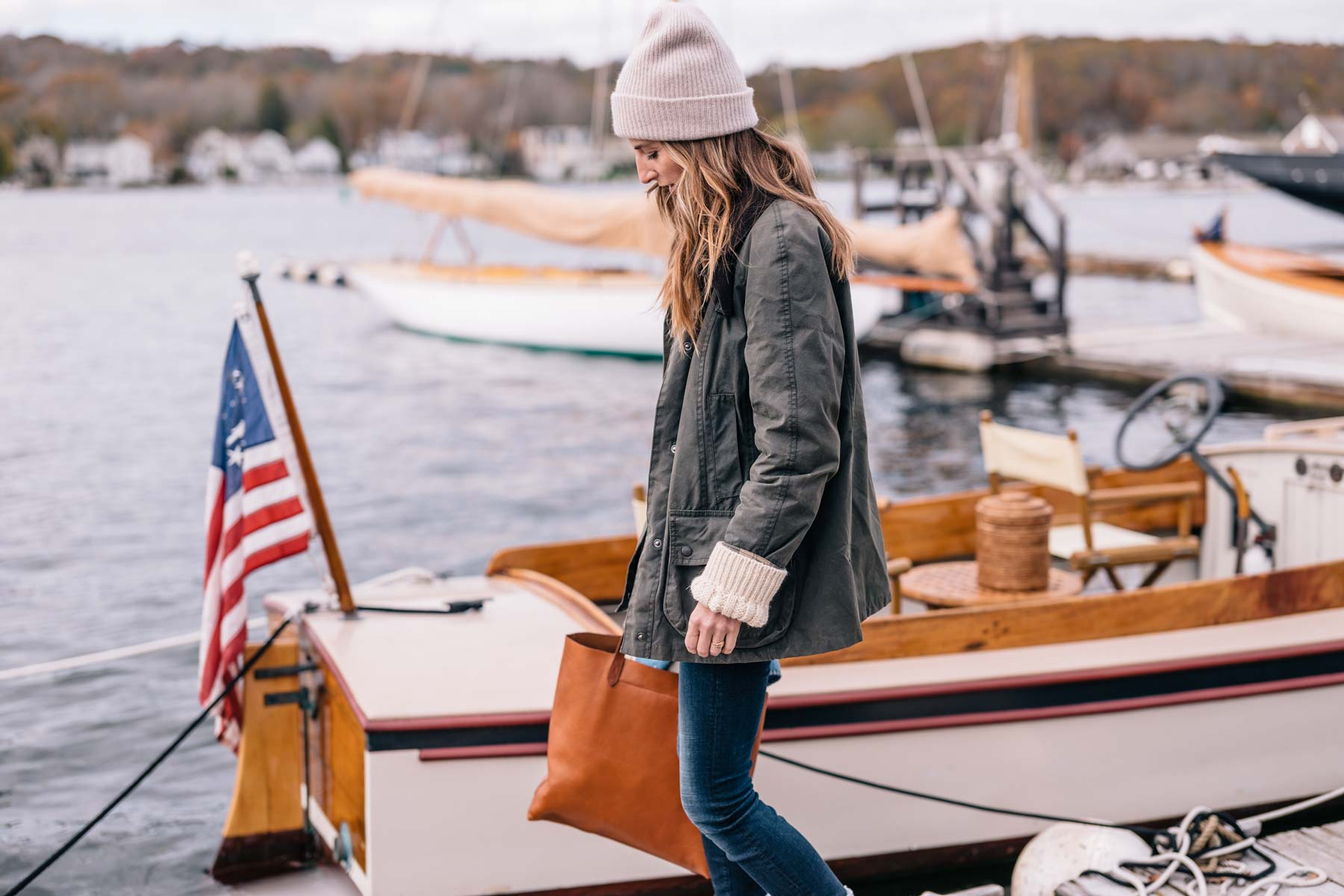 Jess Ann Kirby wears a Barbour jacket with a cashmere beanie for fall in New England