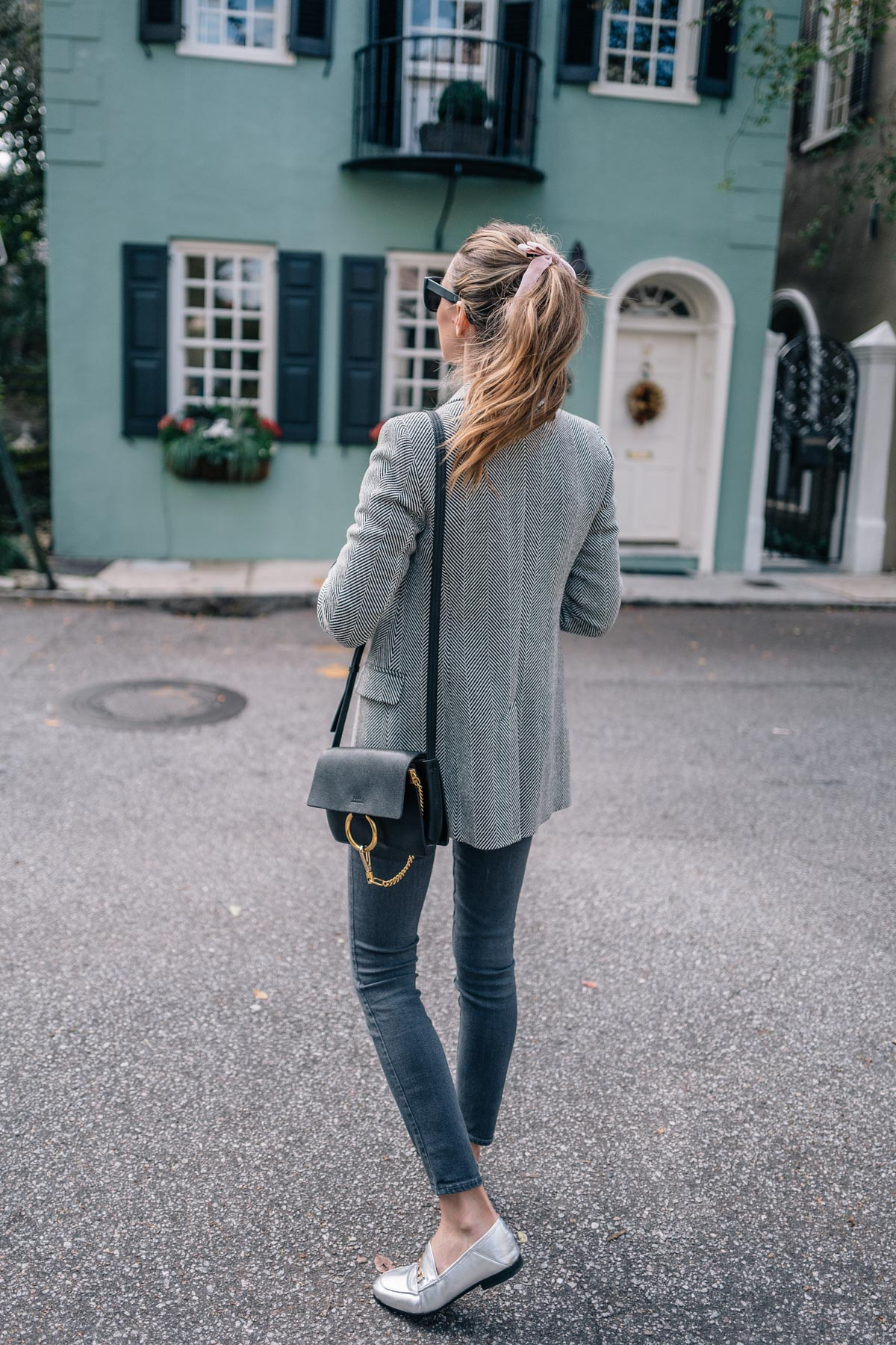 Jess Ann Kirby wears a Reiss Blazer, Paige Jeans, Sam EDelman Loafers and Chloe Bag in Charleston South Carolina