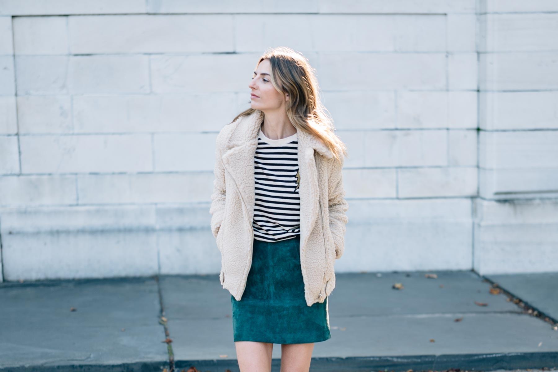 Jess Ann Kirby wears an H&M faux shearling moto jacket for a cozy fall look