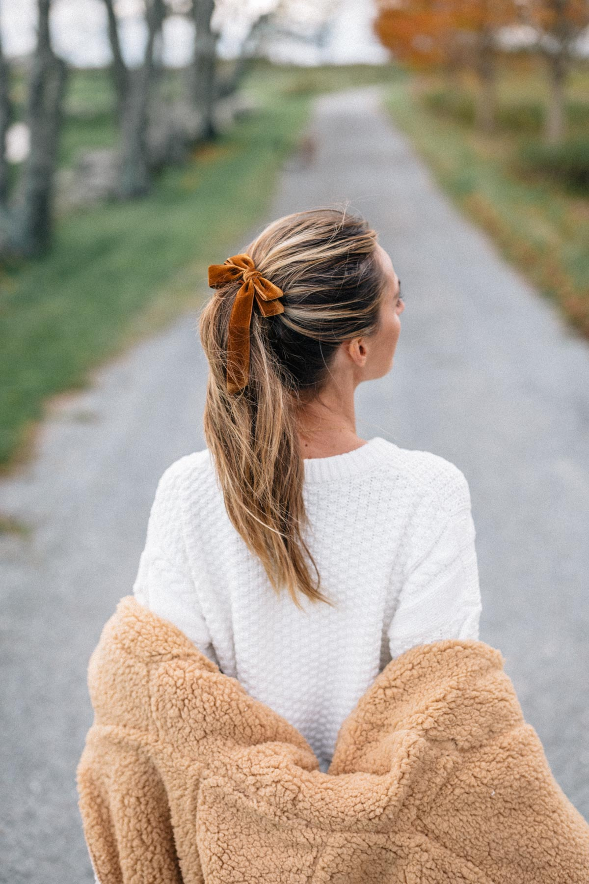 Jess Ann Kirby styles a fall look featuring the Urban Outfitters Magnolia Cozy Reversible Coat and a velvet bow from J.Crew