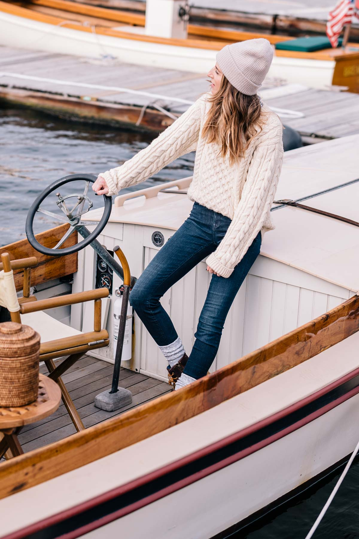 Jess Ann Kirby wears sperry boots and an LL Bean fisherman sweater with a cashmere beanie to weather New England in the fall